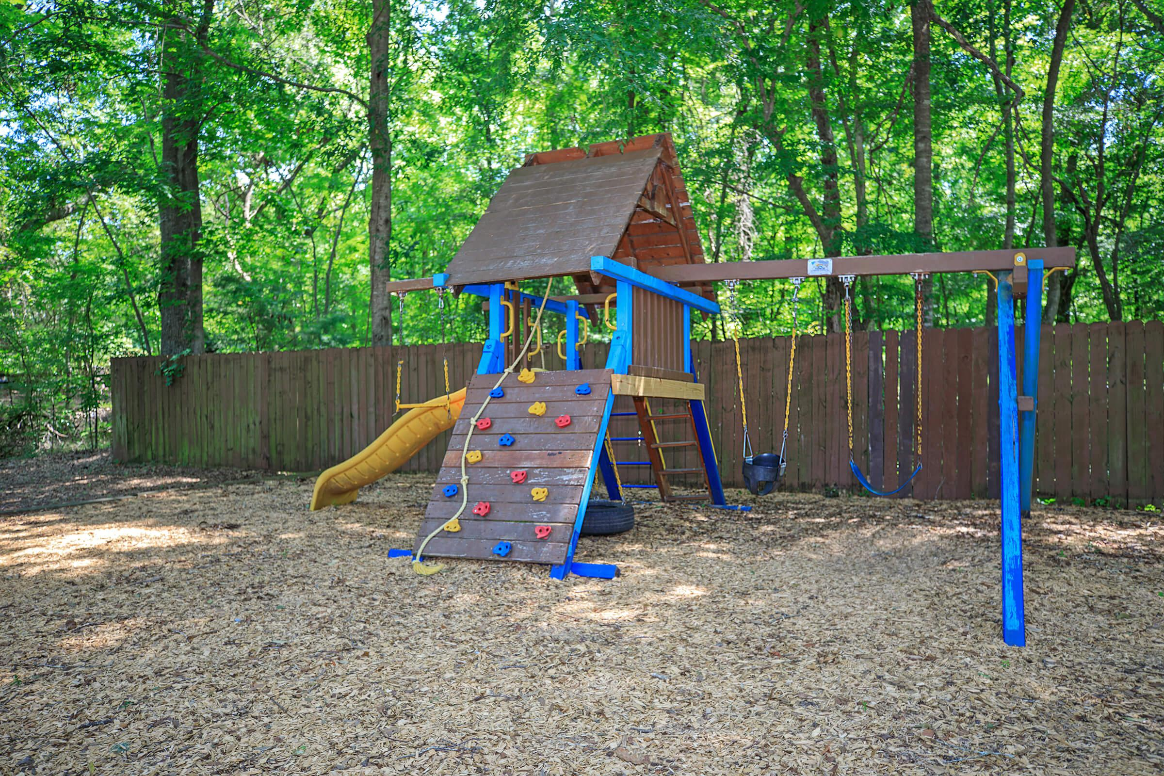 a playground with trees in the background
