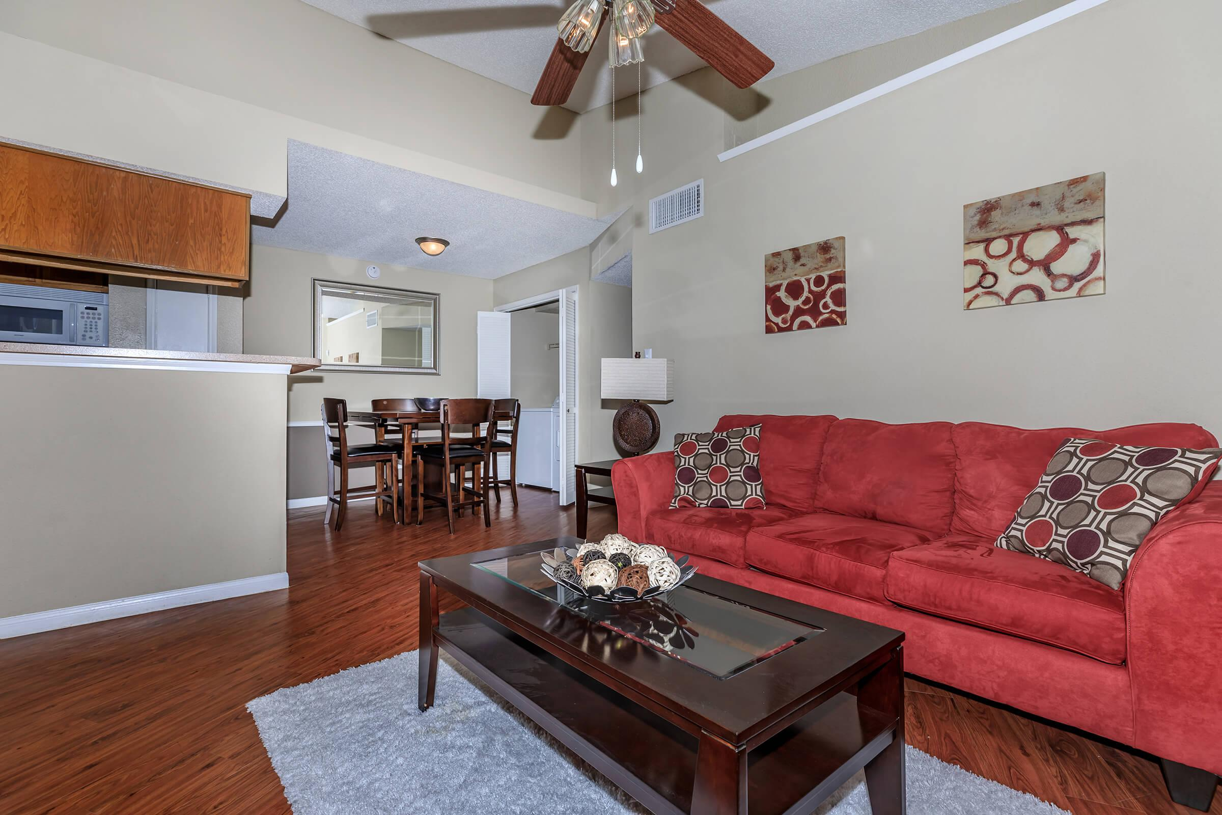 a living room with red floor