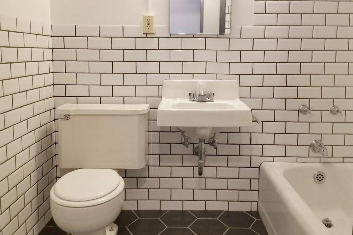 a small white sink in a public restroom