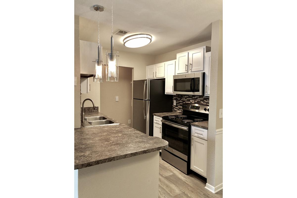 a kitchen with white cabinets