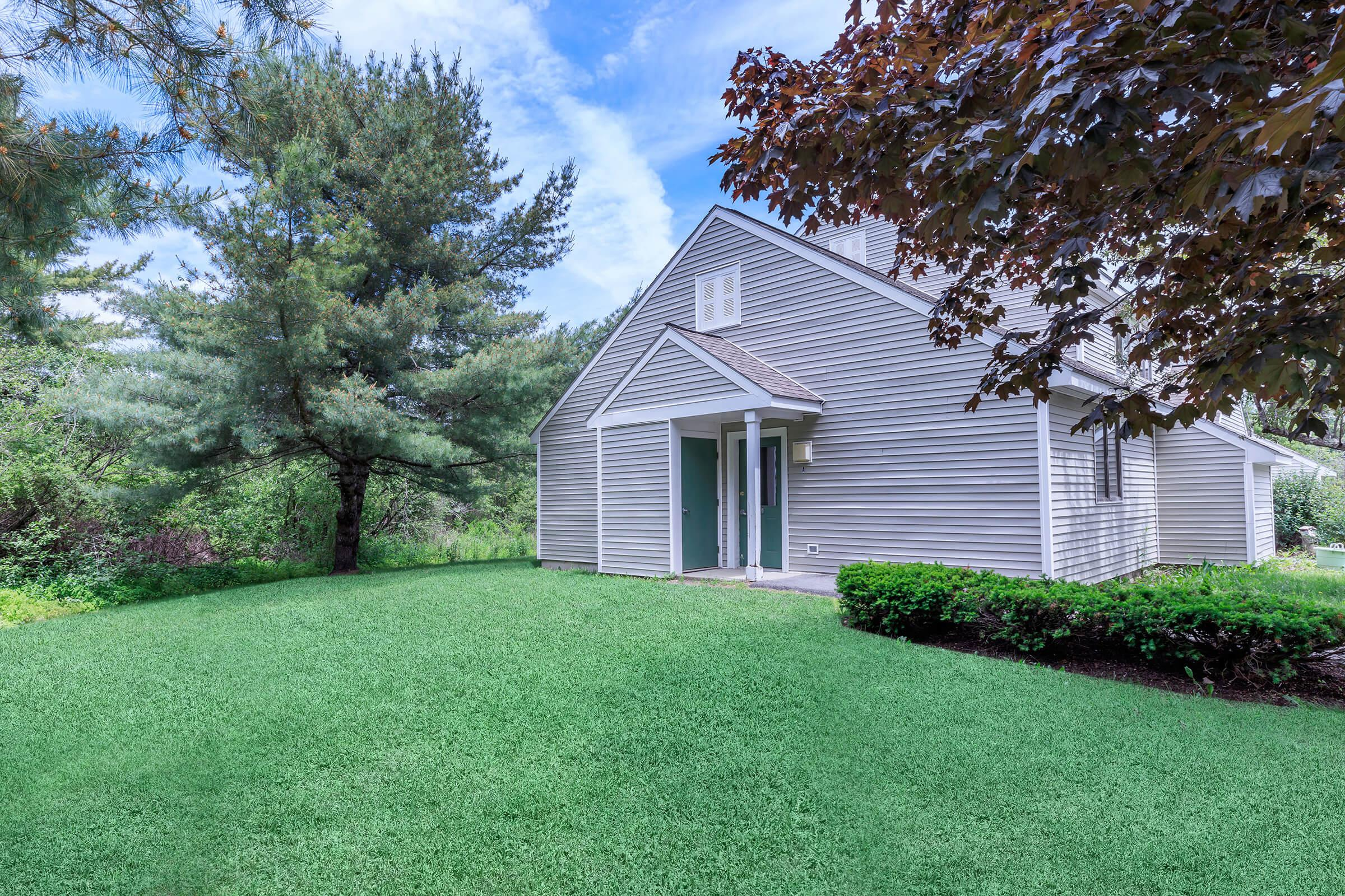 a green lawn in front of a house