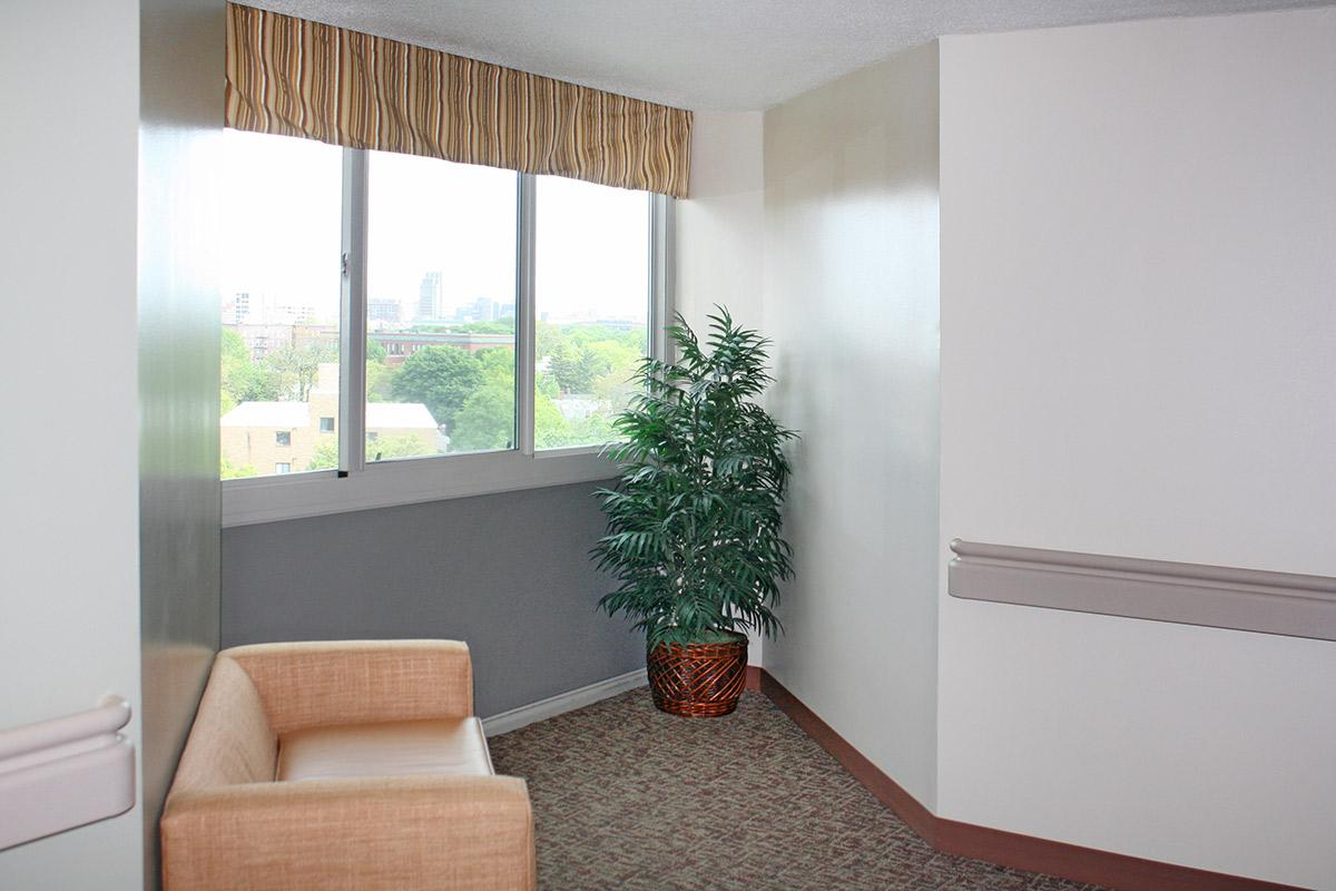 a living room next to a window