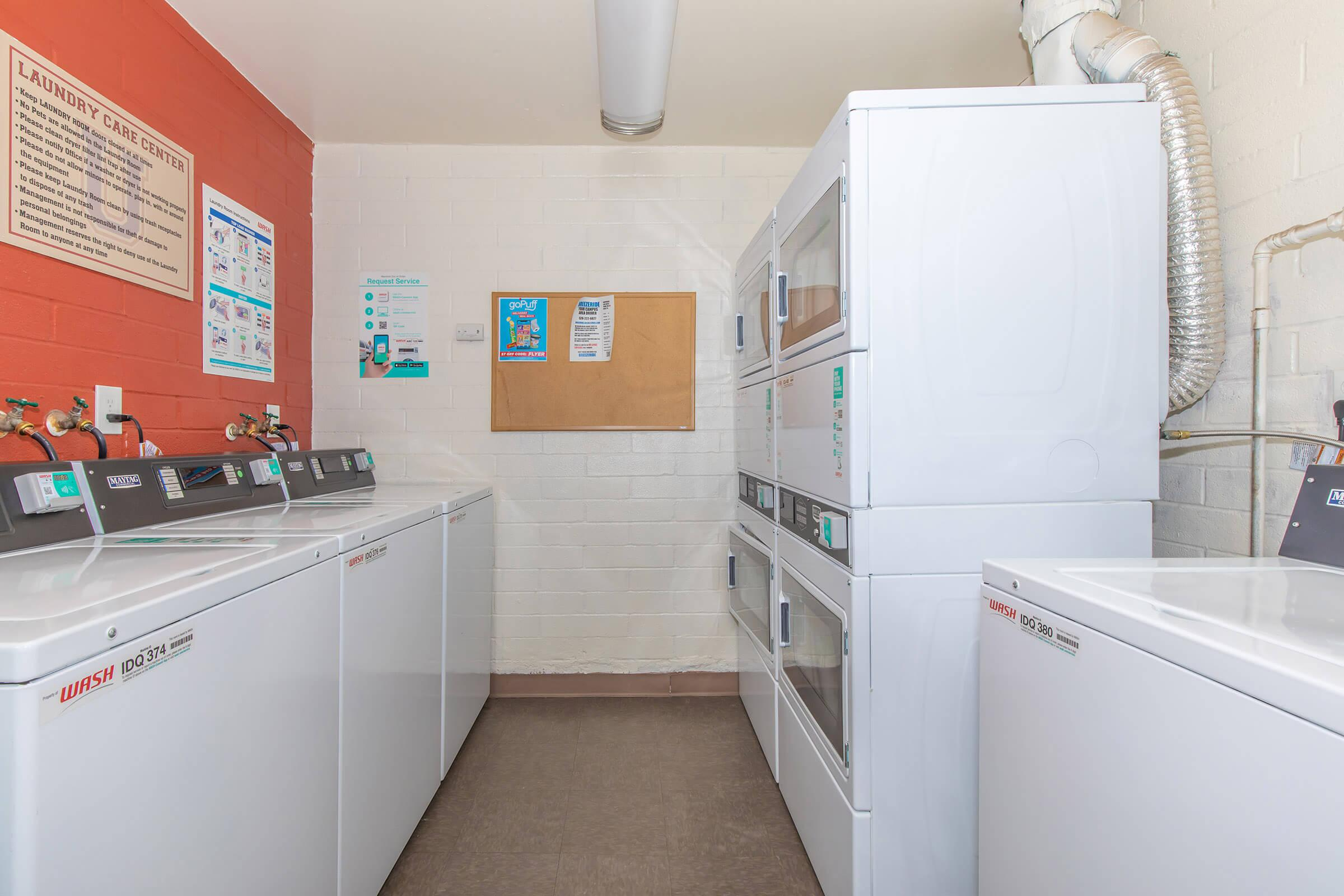 a kitchen with a refrigerator and a microwave