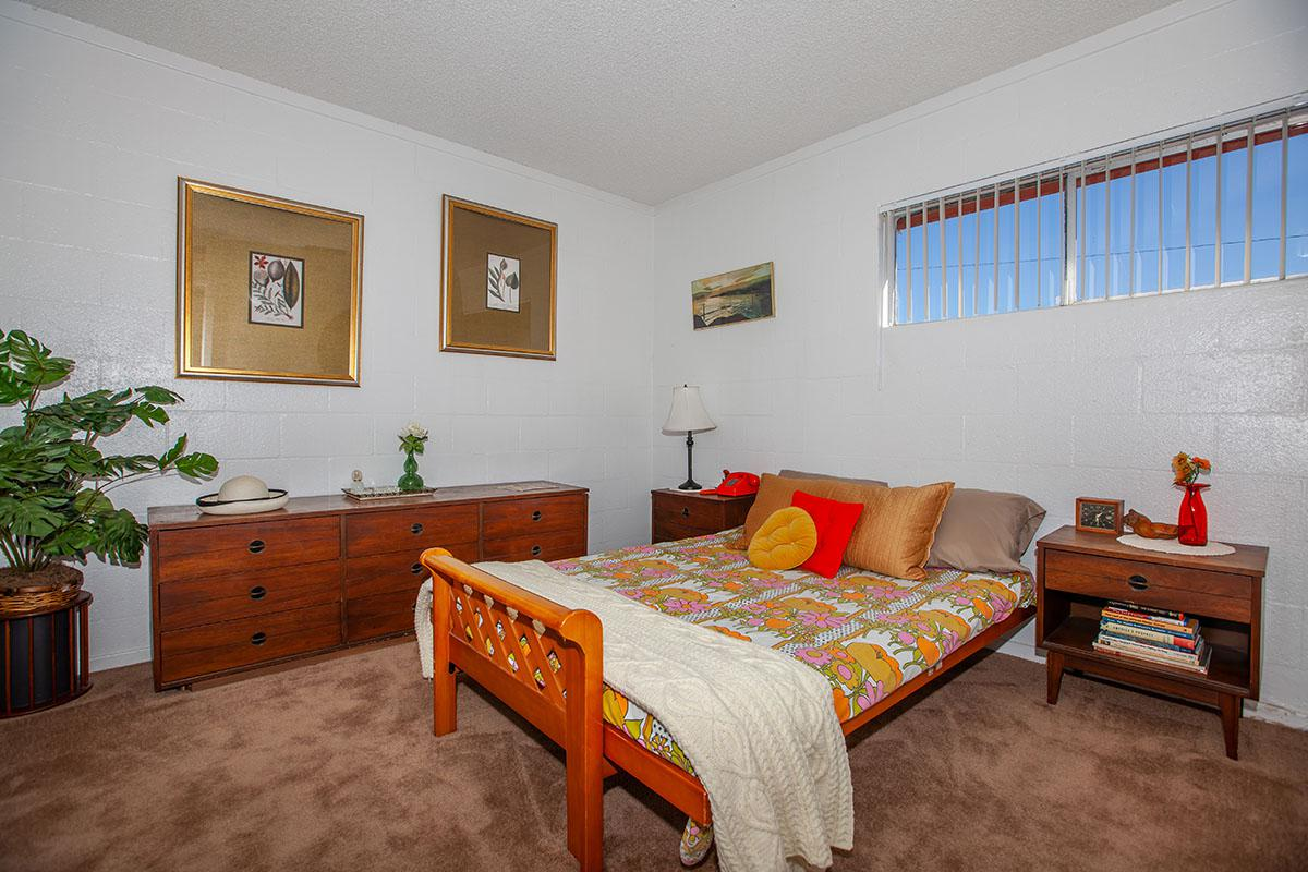 COMFORTABLE BEDROOM AT THE PALMS APARTMENTS IN LAS VEGAS