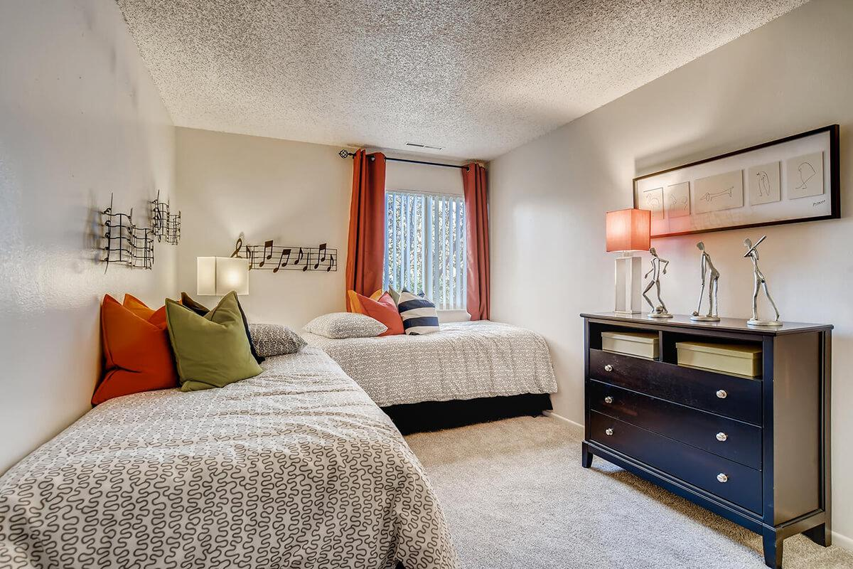 a bedroom with a large bed sitting in a living room