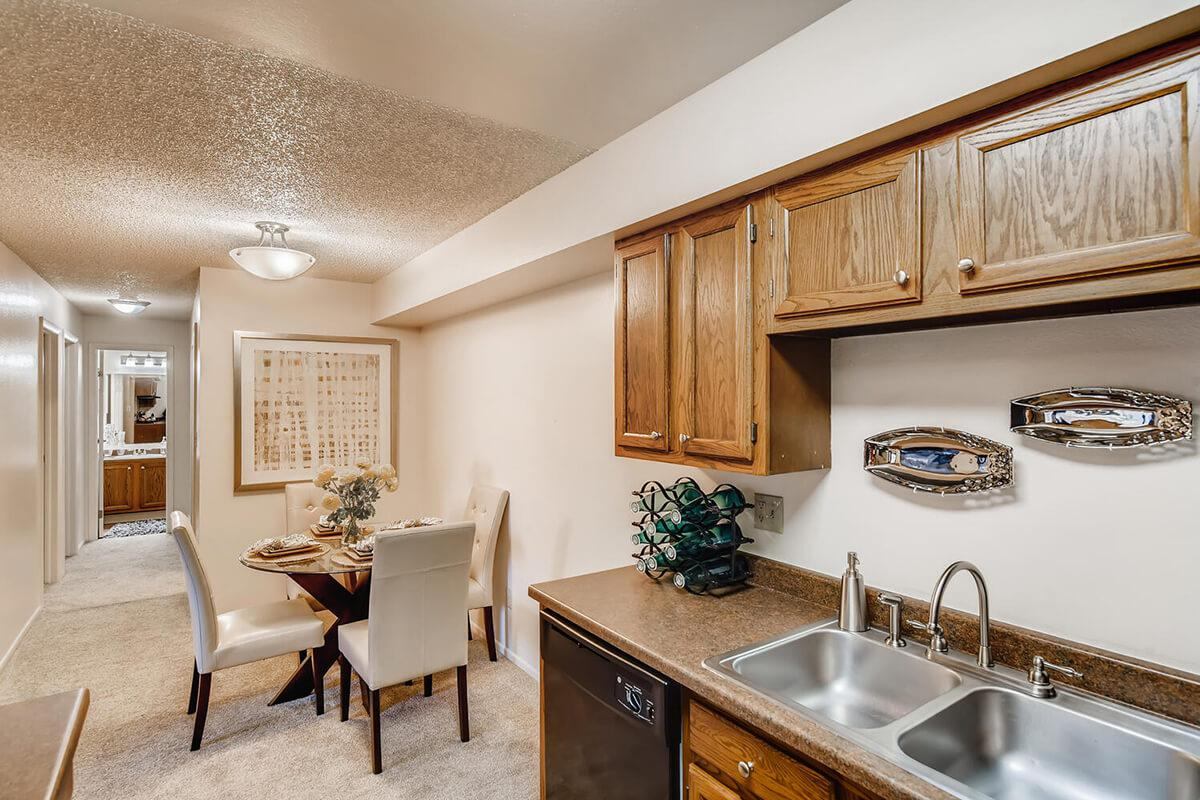 a kitchen with a sink and a dining room table
