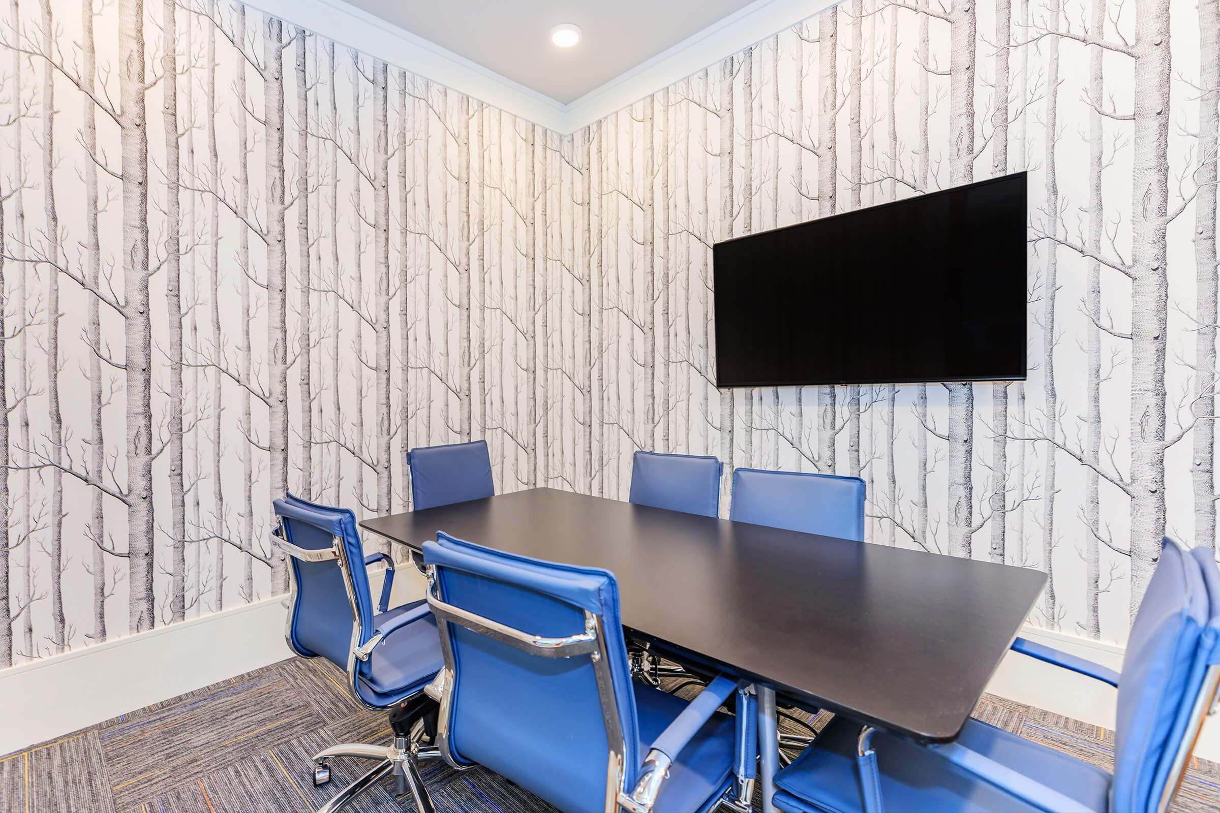 Business center conference room available at Ariza Gosling