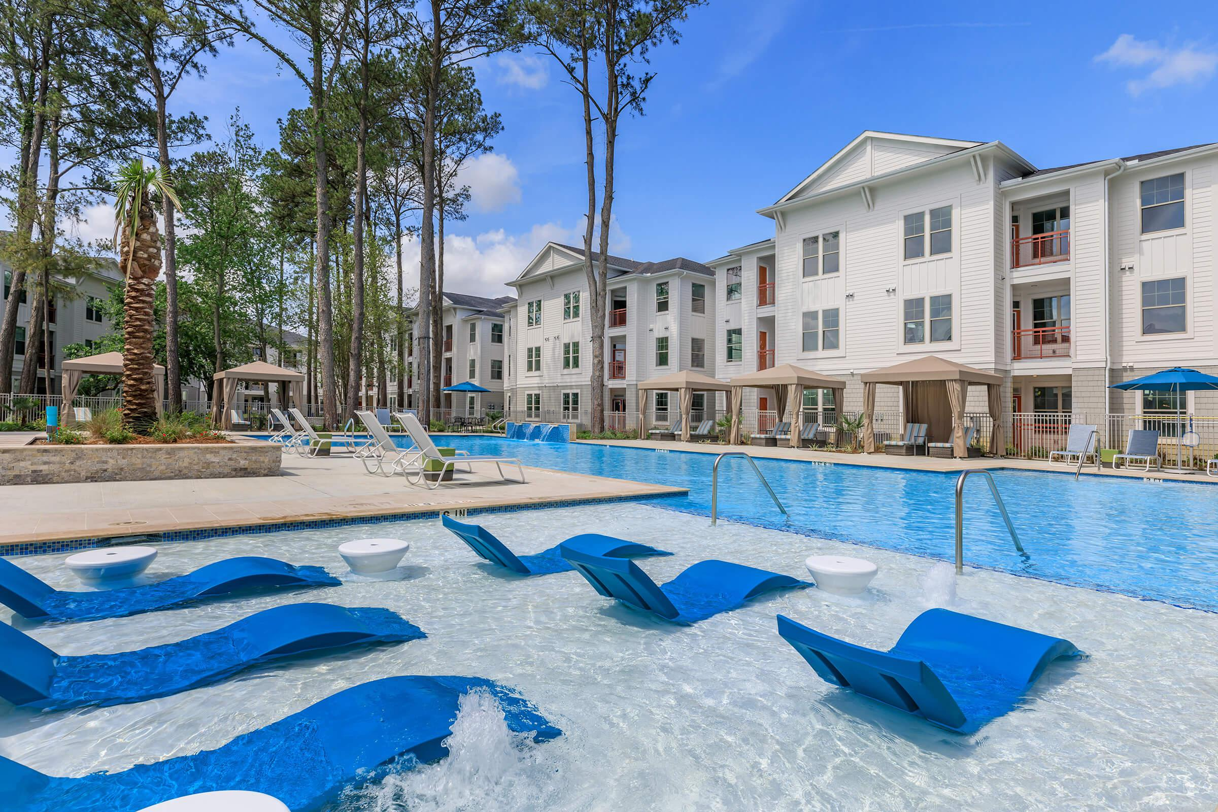 Relax poolside at Ariza Gosling in Spring, Texas