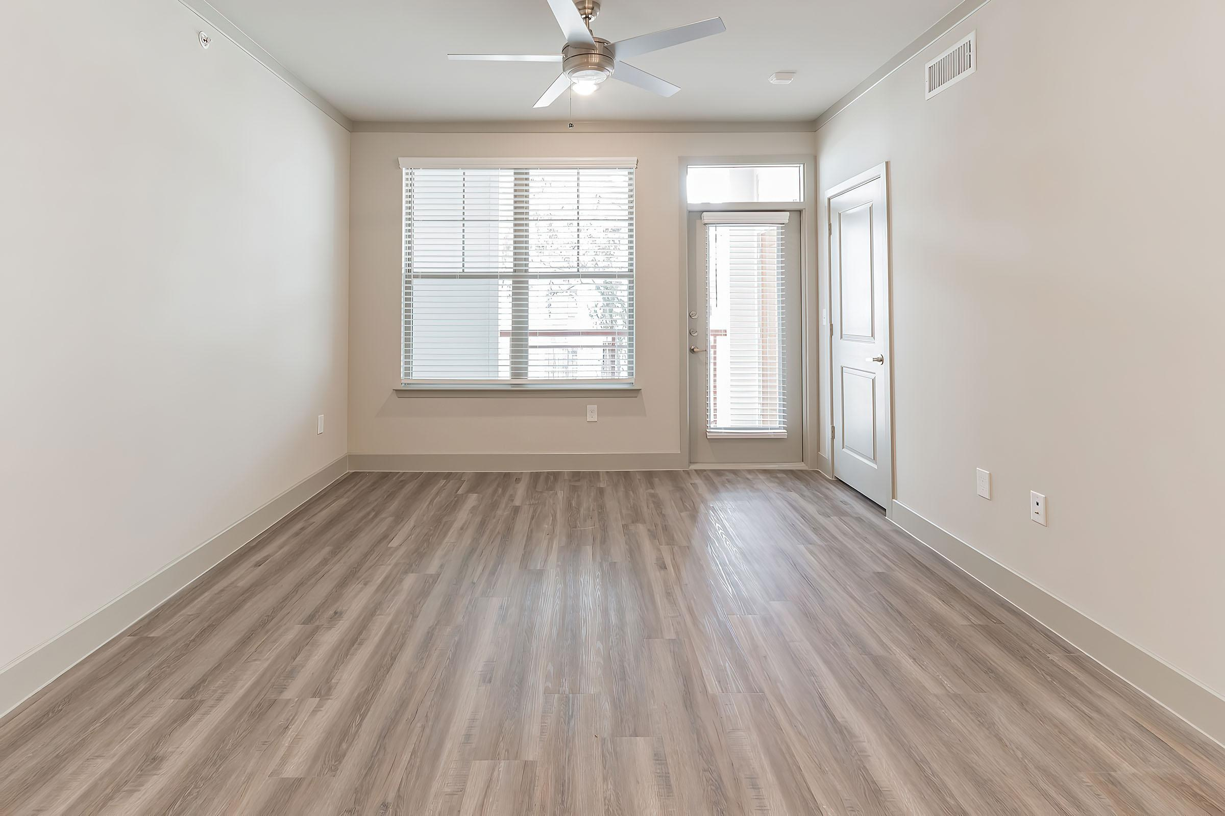 a wooden floor next to a window
