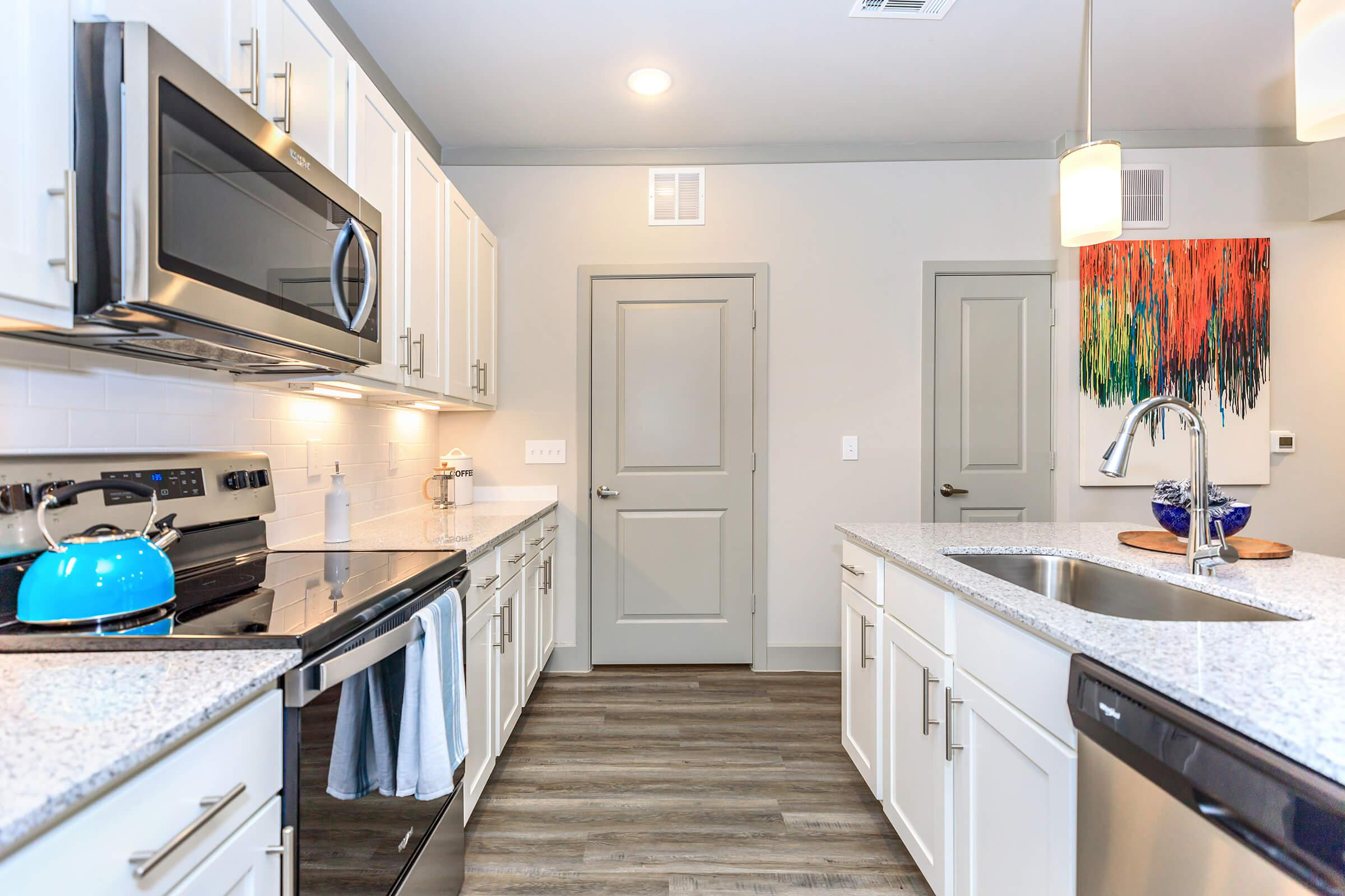 Fully-equipped kitchens at Ariza Gosling in Spring, Texas