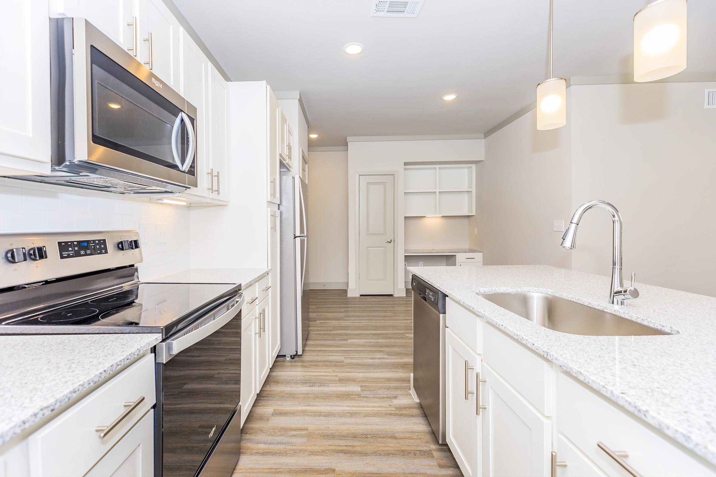 Well-equipped kitchens at Ariza Gosling in Spring, Texas