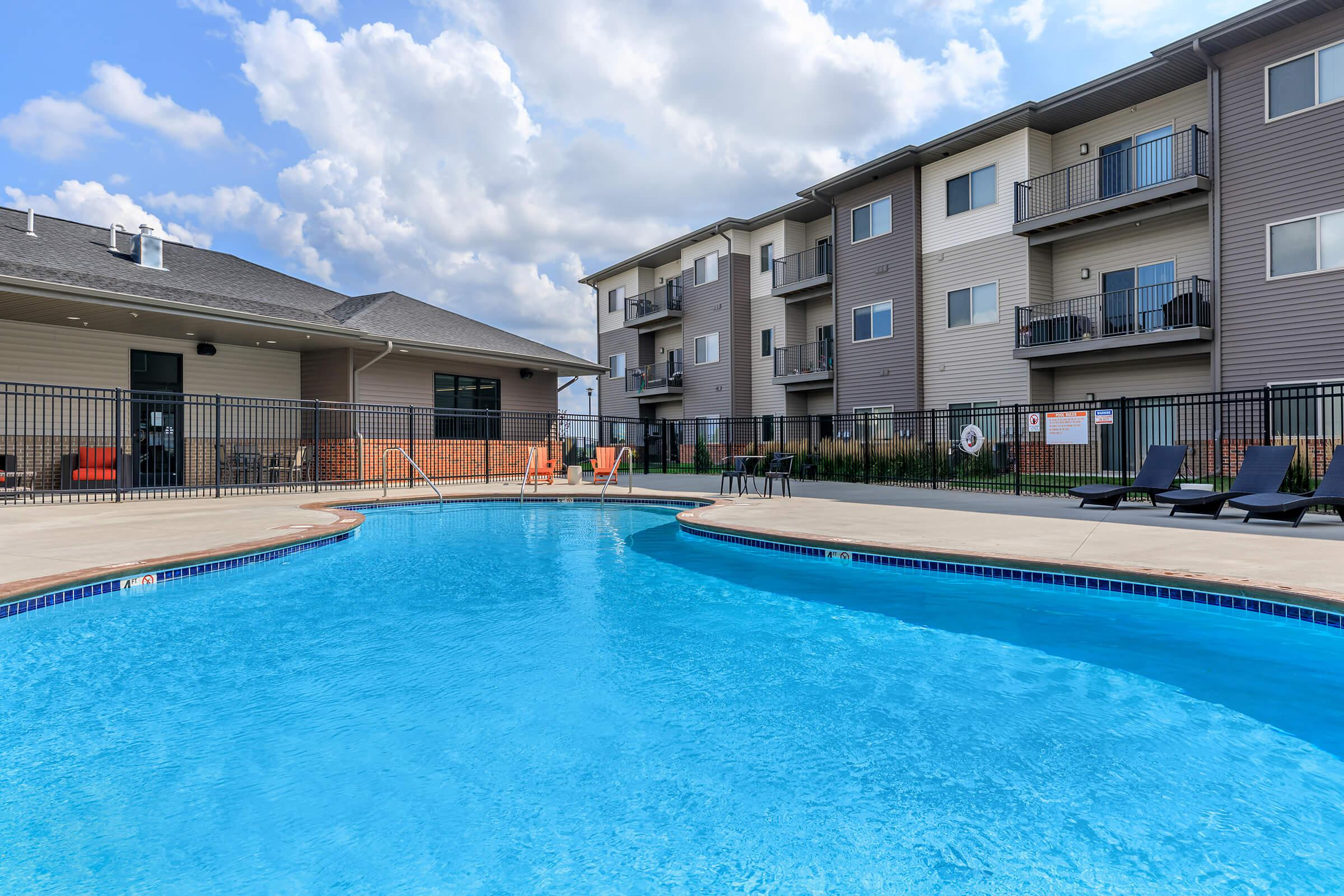 SOAK UP THE SUN AT OUR SHIMMERING SWIMMING POOL AT THE SUMMIT AT SUNNYBROOK VILLAGE