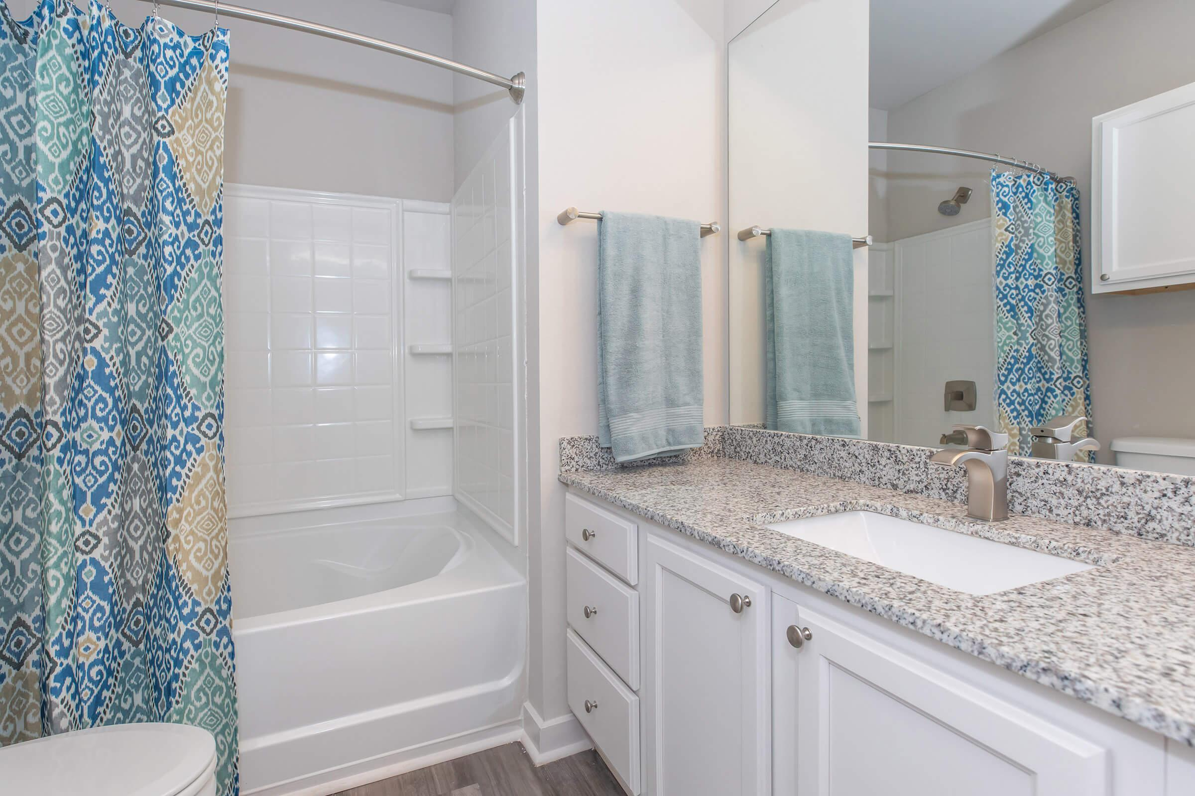 a shower curtain next to a sink