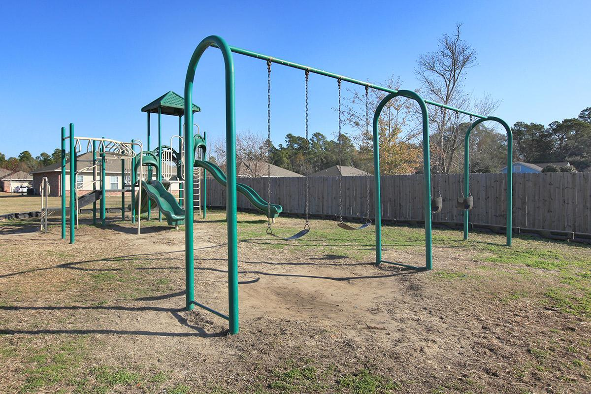a playground in a fenced in area