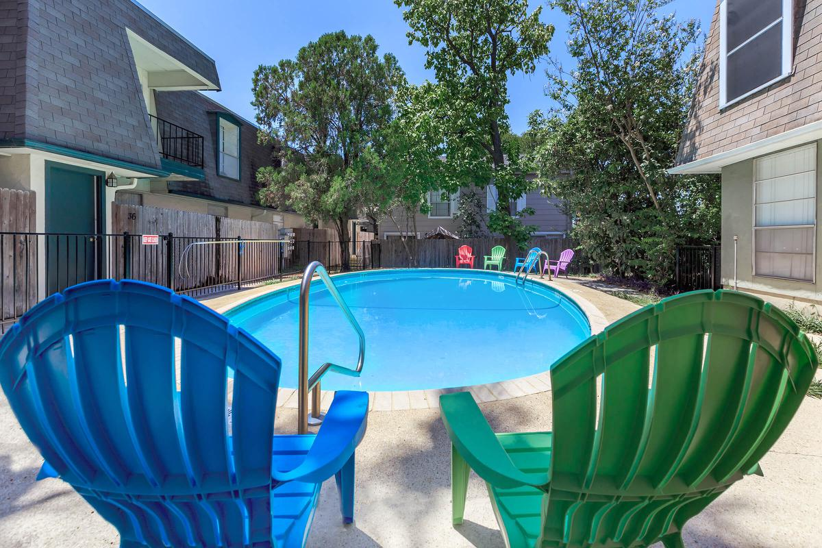 a chair sitting in front of a pool