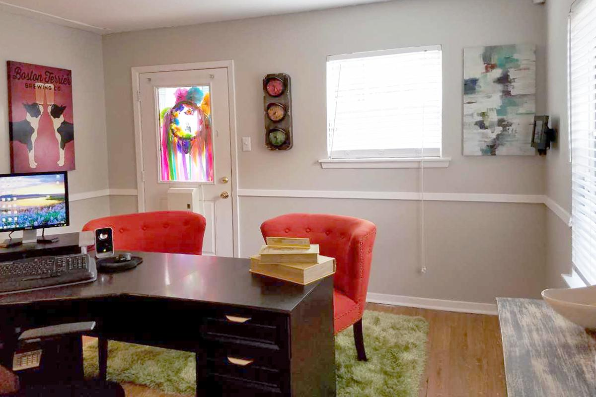 a room filled with furniture and a tv on a table