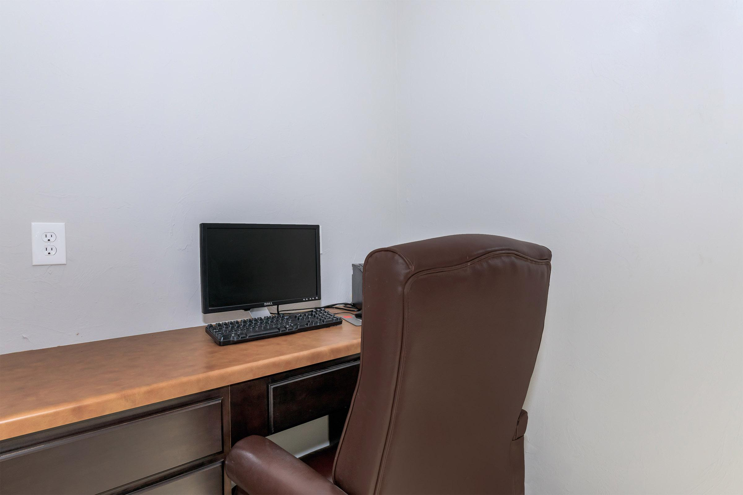 a brown leather chair in a room