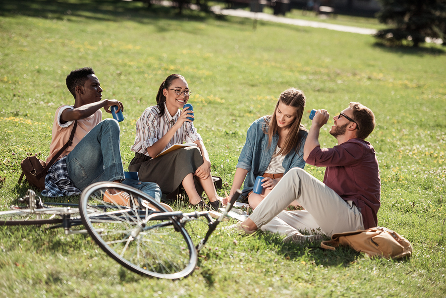 a group of people sitting at a park