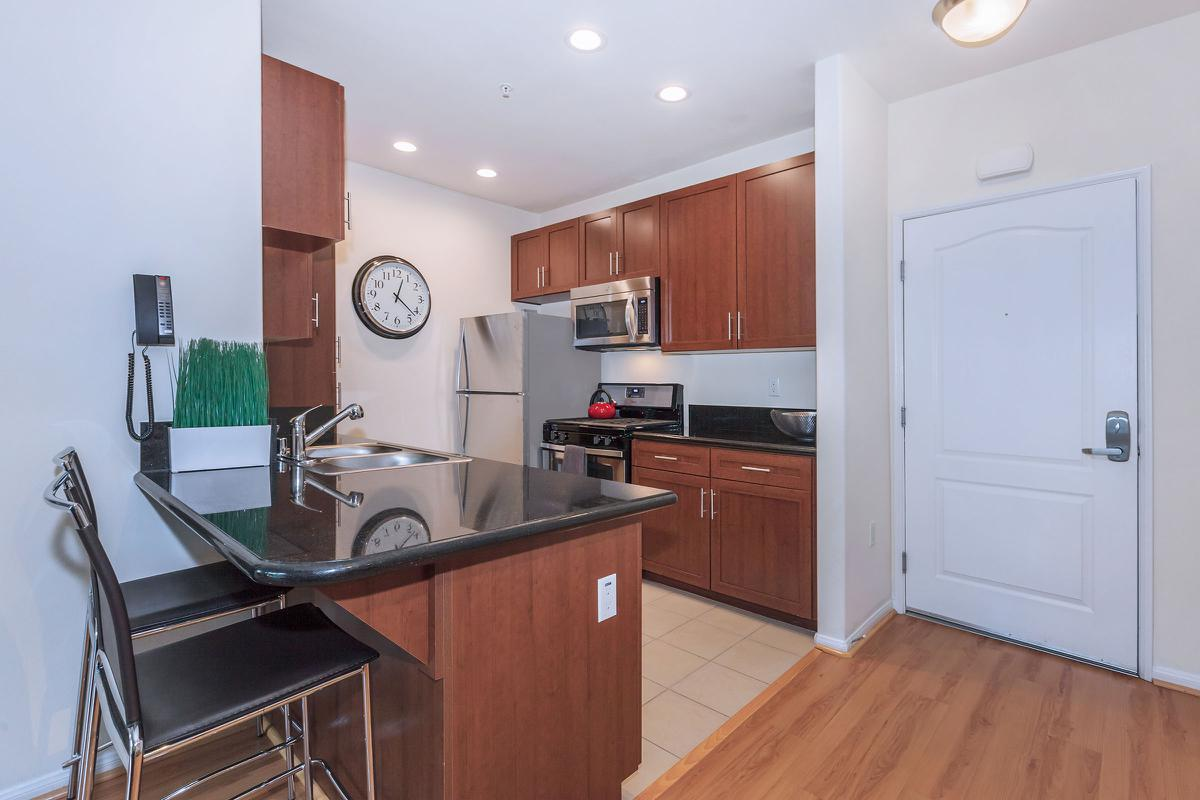 a kitchen with a wood floor