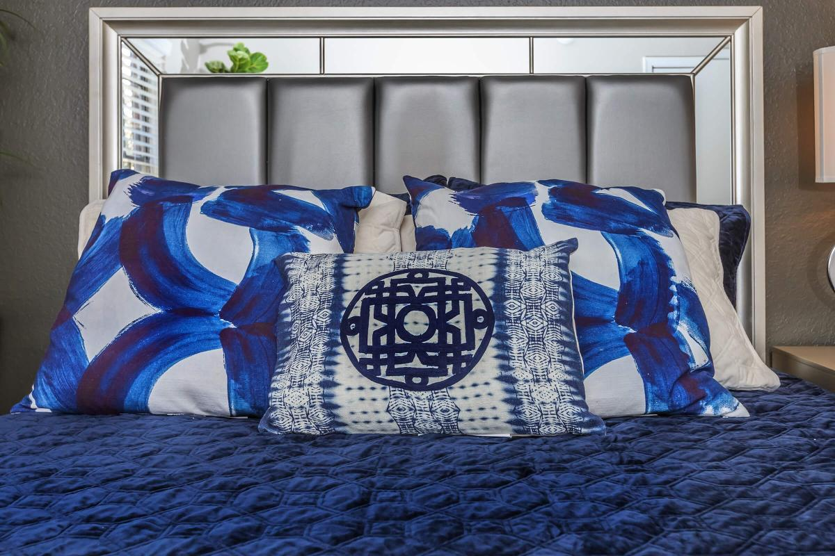 a bed with a blue blanket