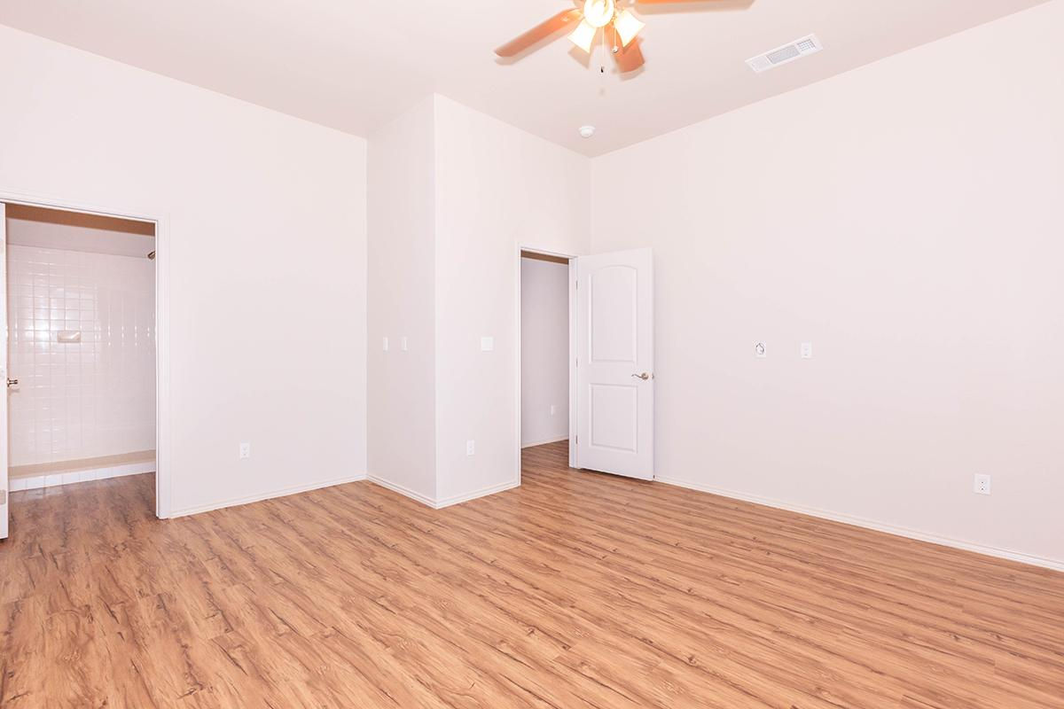 a large empty room with a wooden floor