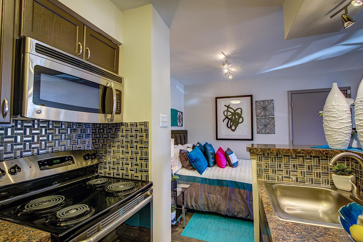 a stove top oven sitting inside of a room