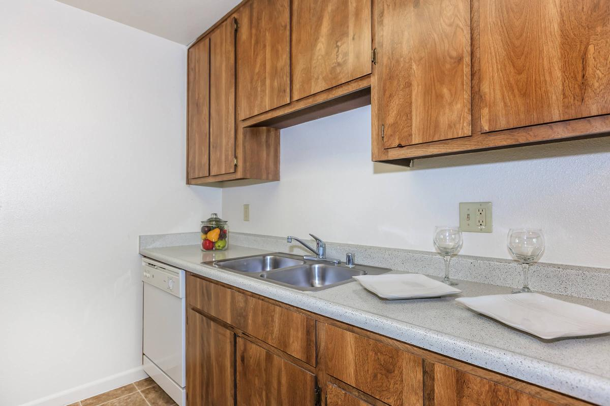 a kitchen with wooden cabinets and a sink