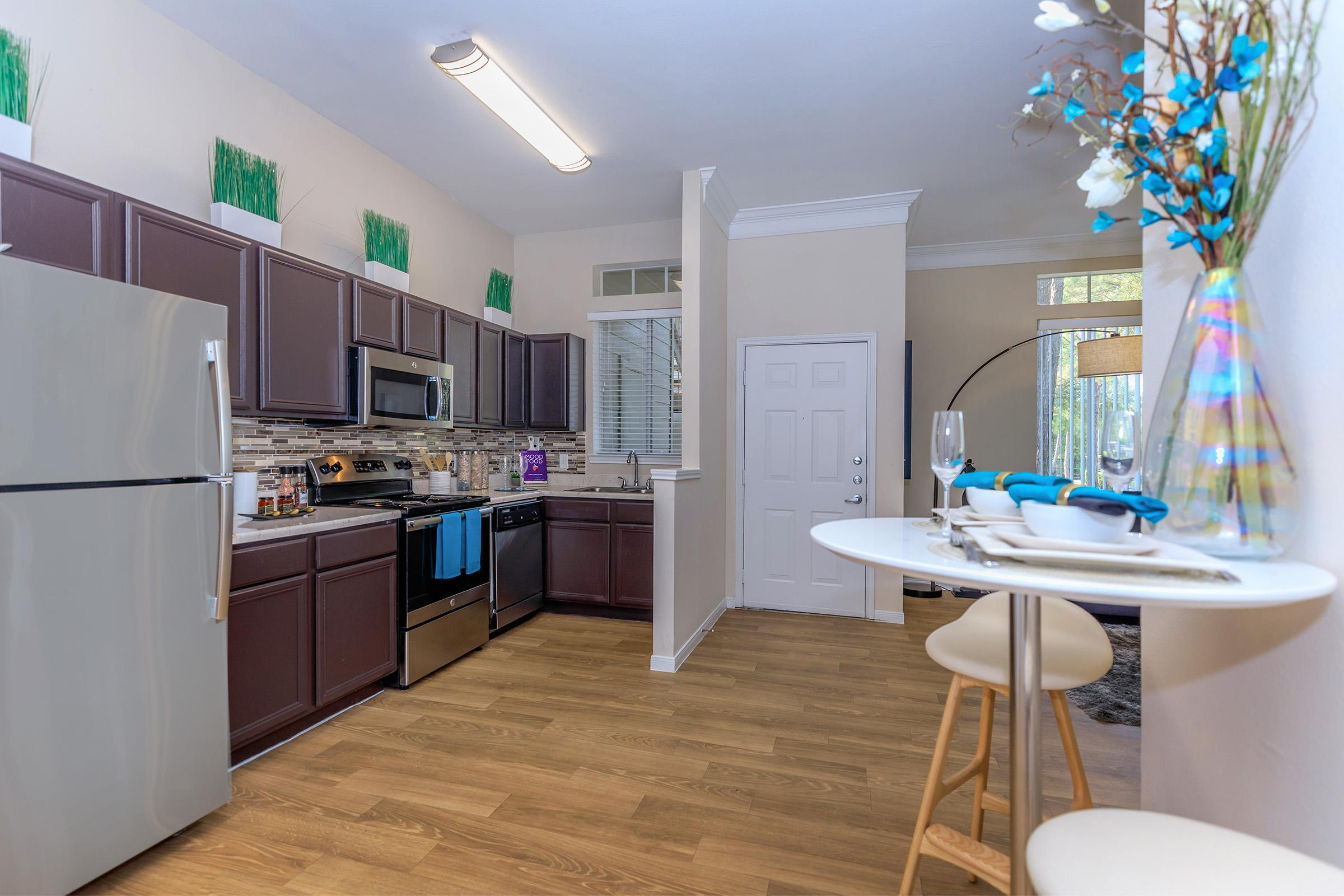 a kitchen with a table in a room