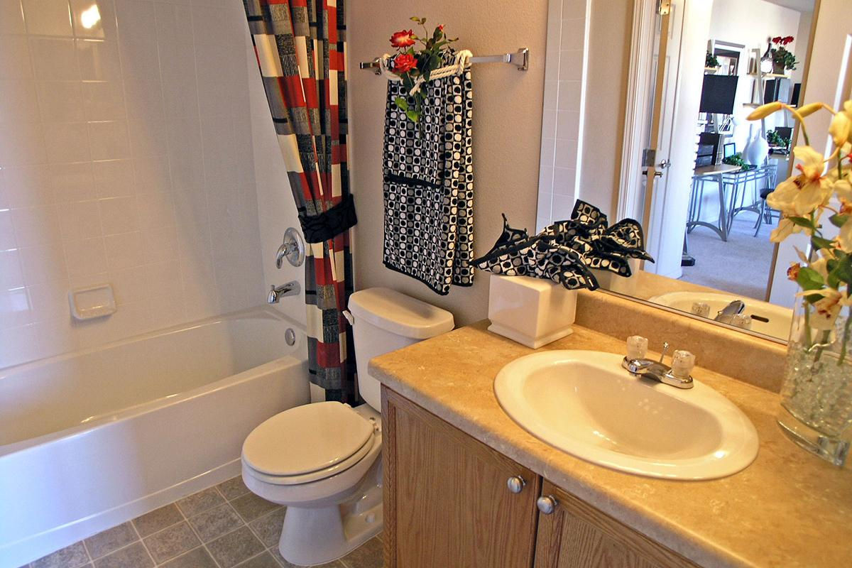 BATHROOM WITH RED AND GREY SHOWER CURTAIN