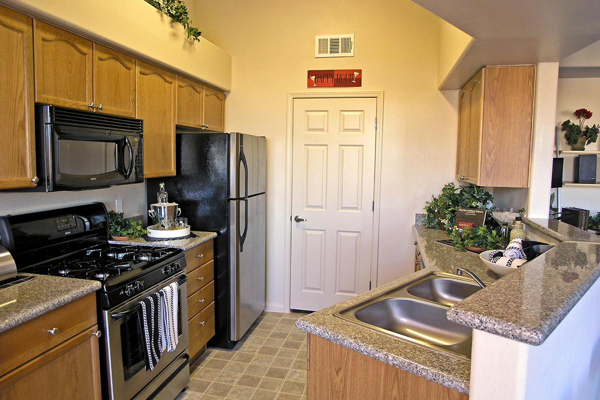 KITCHEN WITH STAINLESS-STEEL APPLIANCES