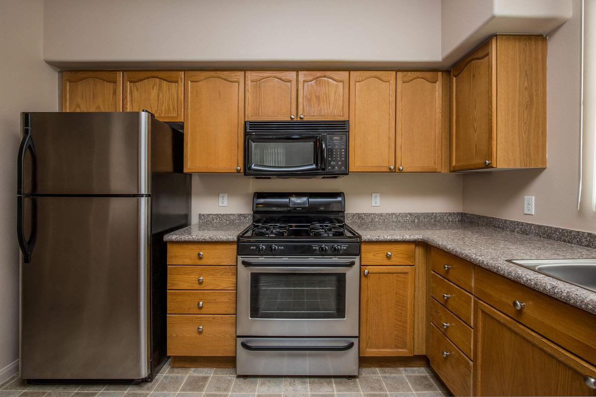 a kitchen with a stove top oven sitting next to a microwave