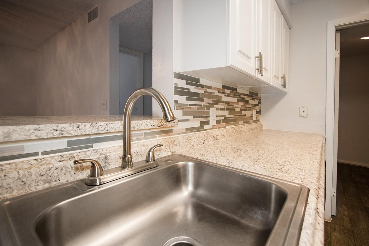 a kitchen with a stainless steel sink