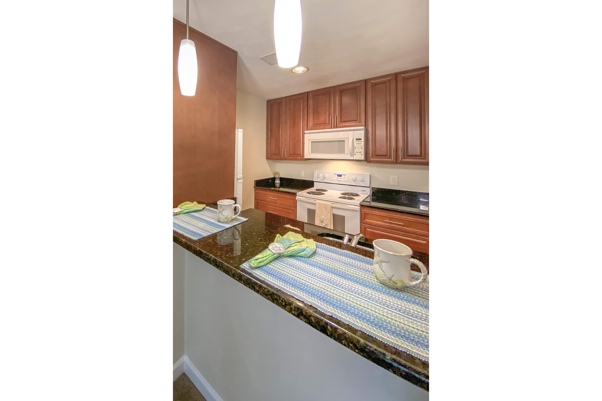 a double photo of a kitchen