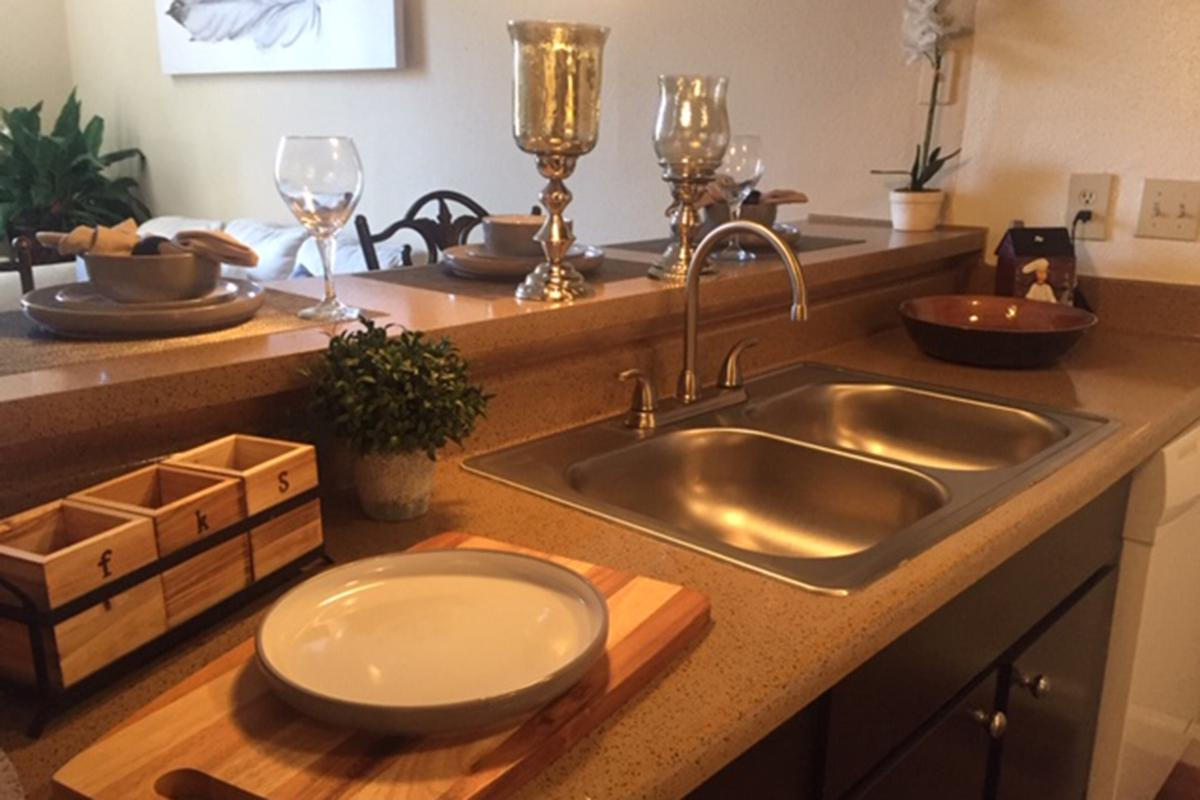 a table topped with lots of counter space and a sink