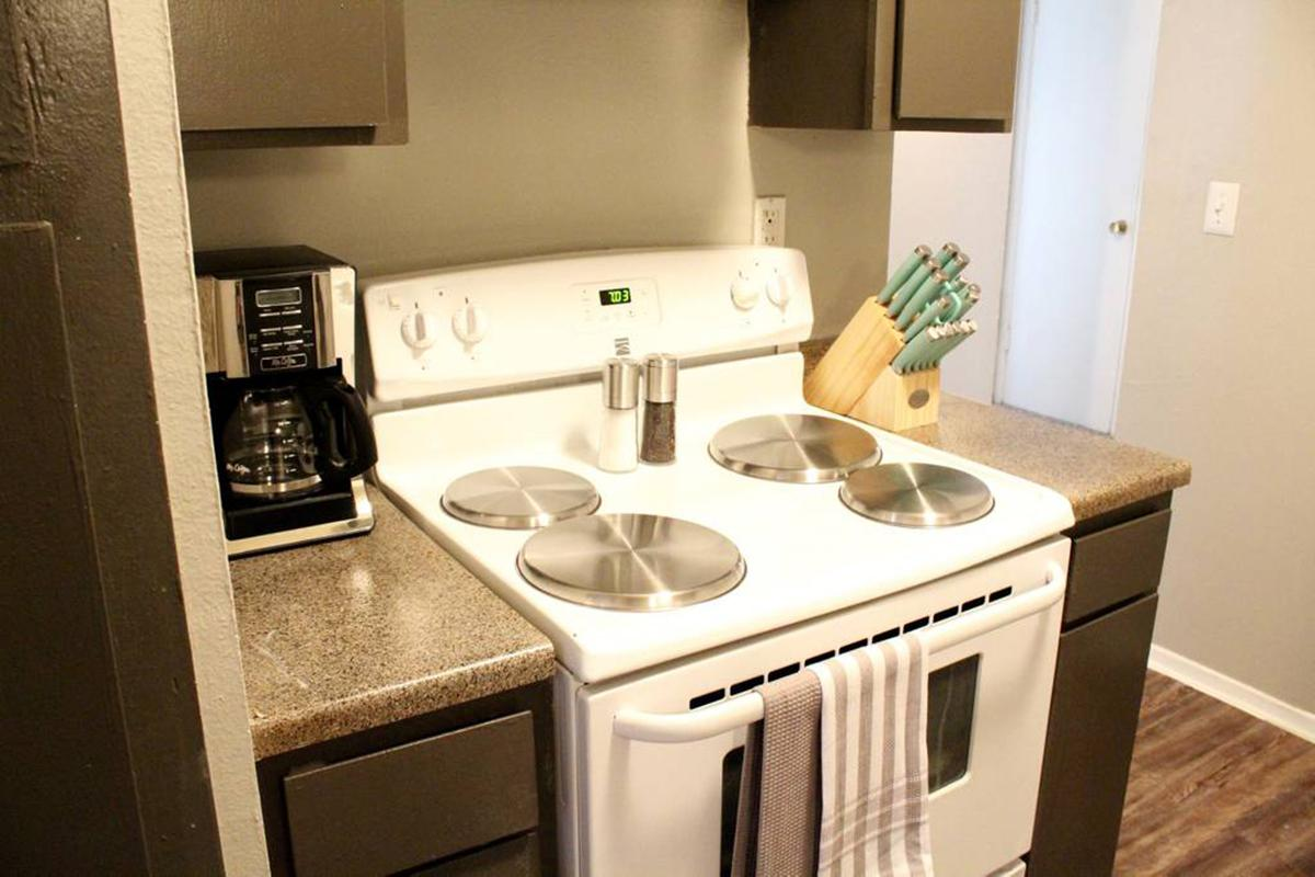 a stove top oven sitting next to a sink