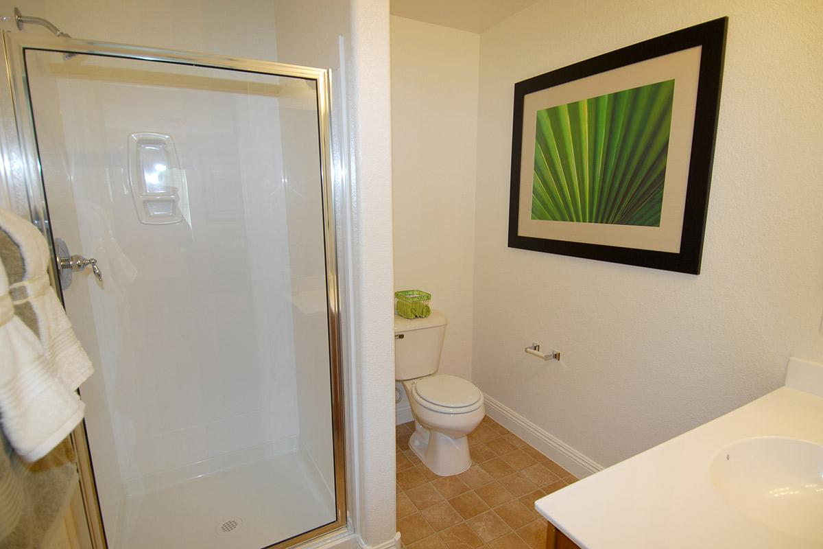 a white tub sitting next to a glass shower door