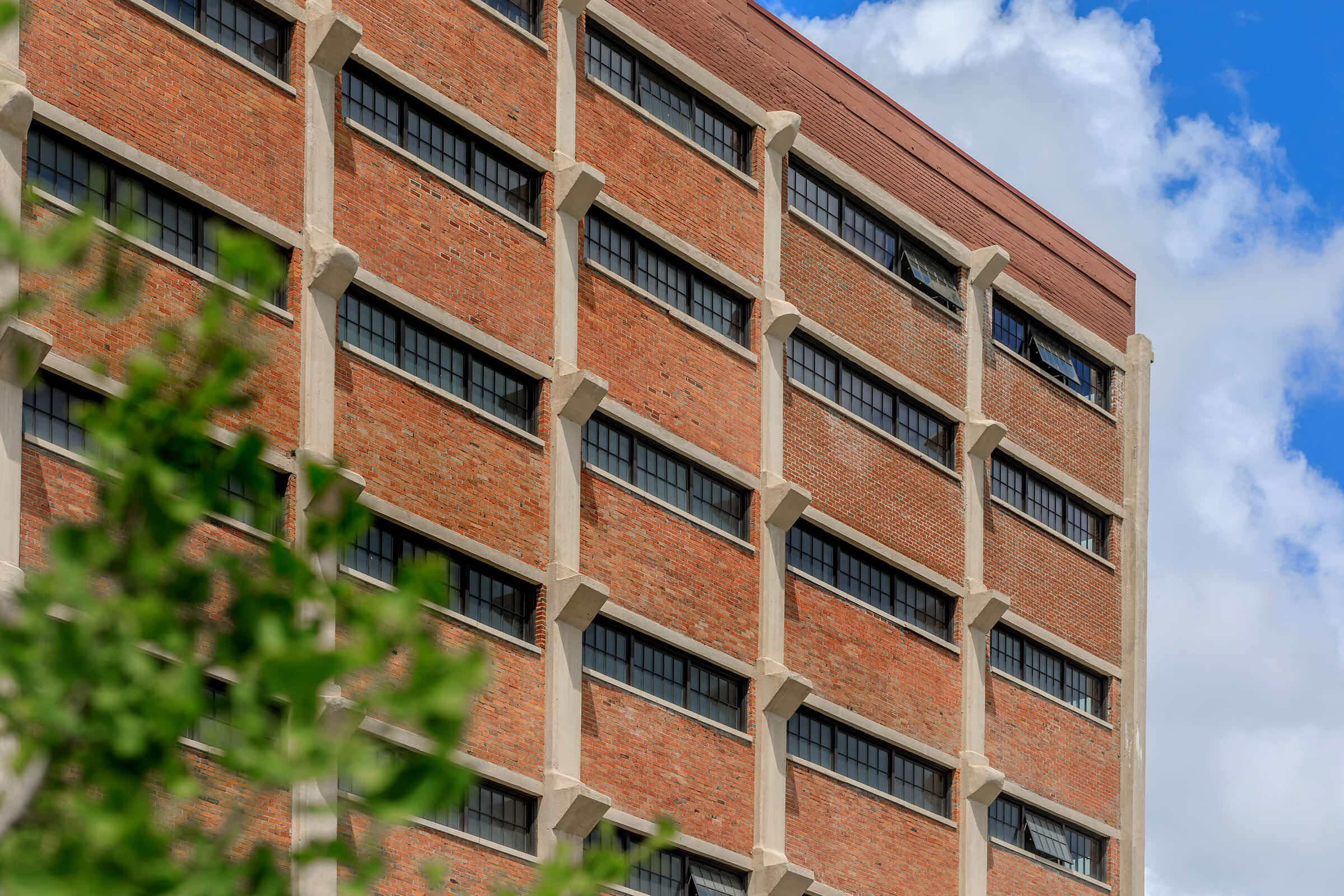 a tall brown brick building