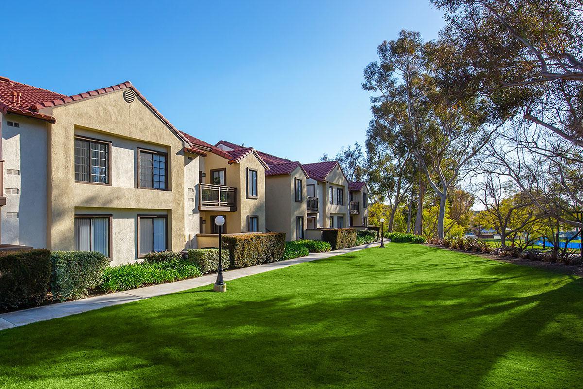 Villa La Paz Apartment Homes community building with green grass