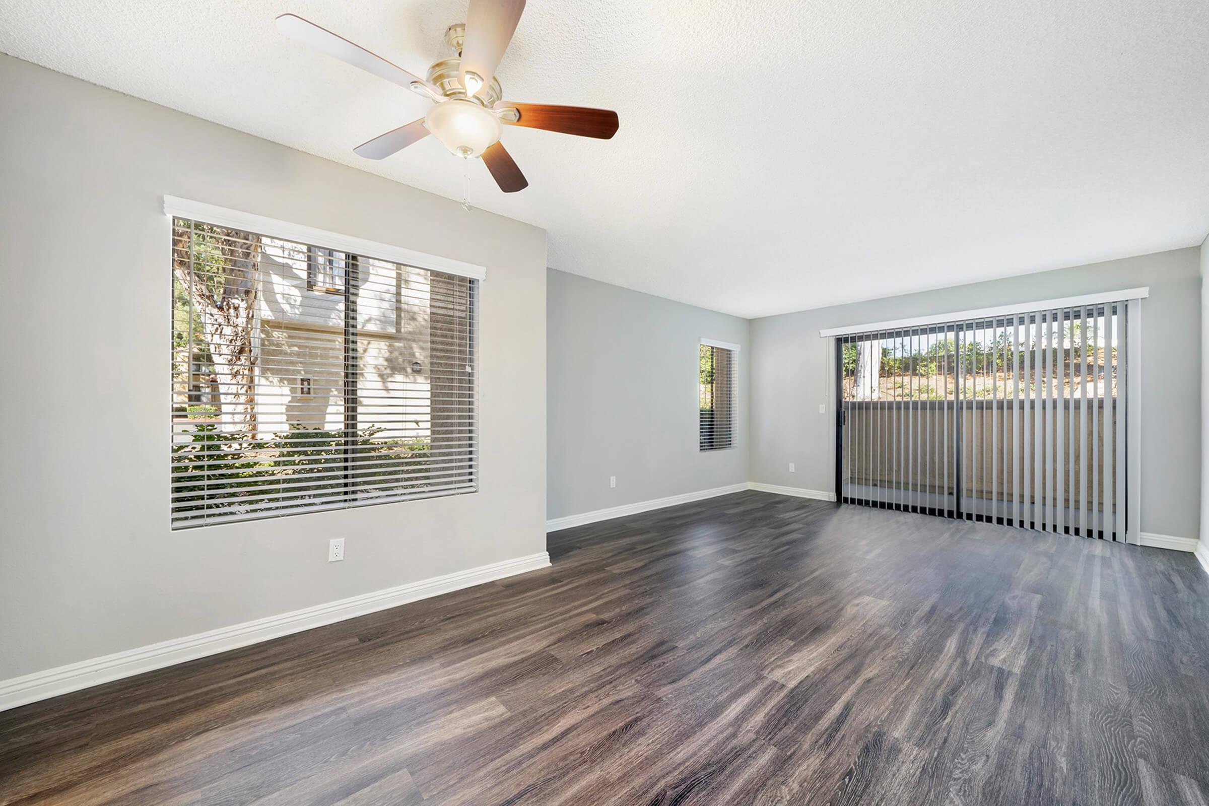 Unfurnished living room with sliding glass doors