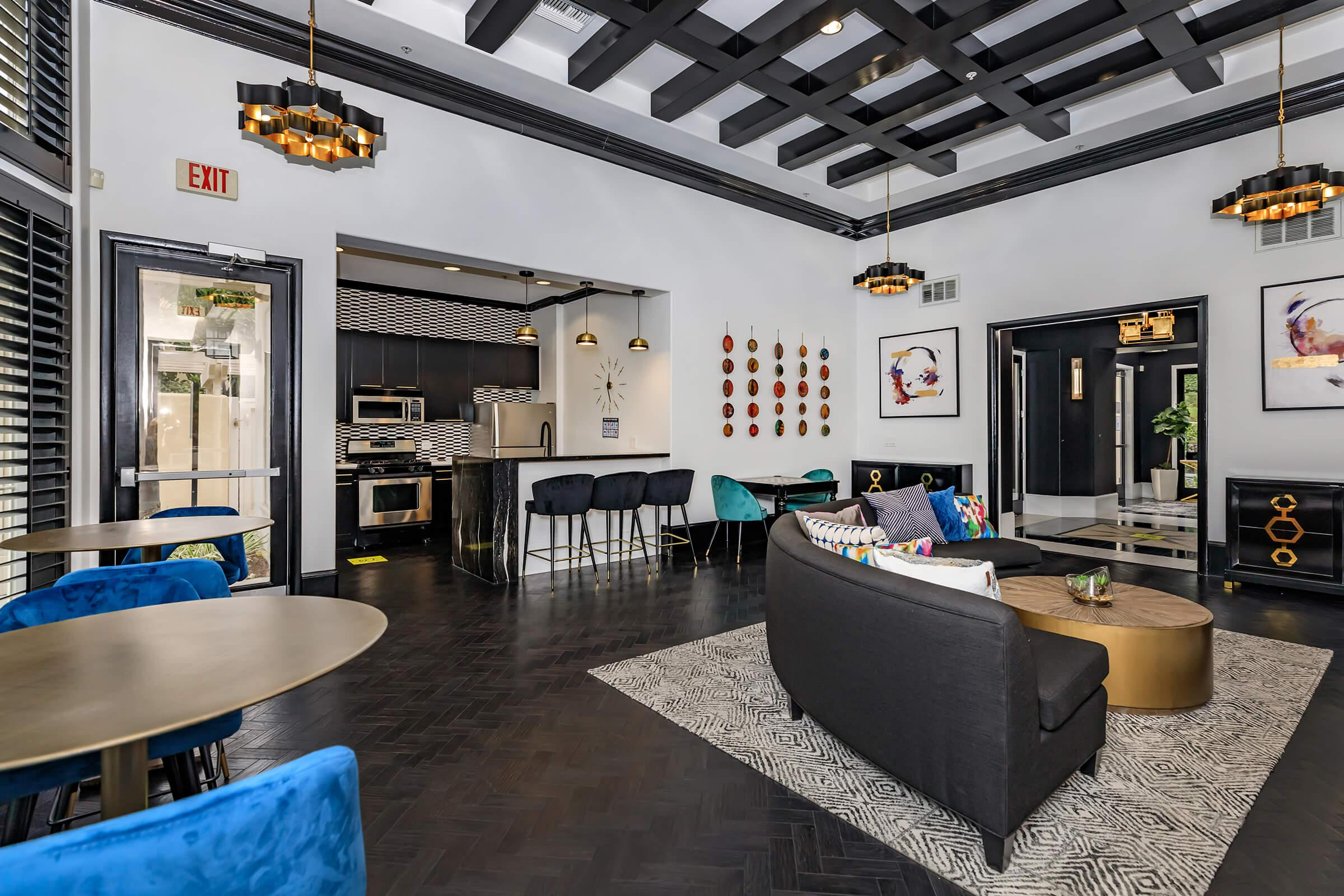 Community room with black couches