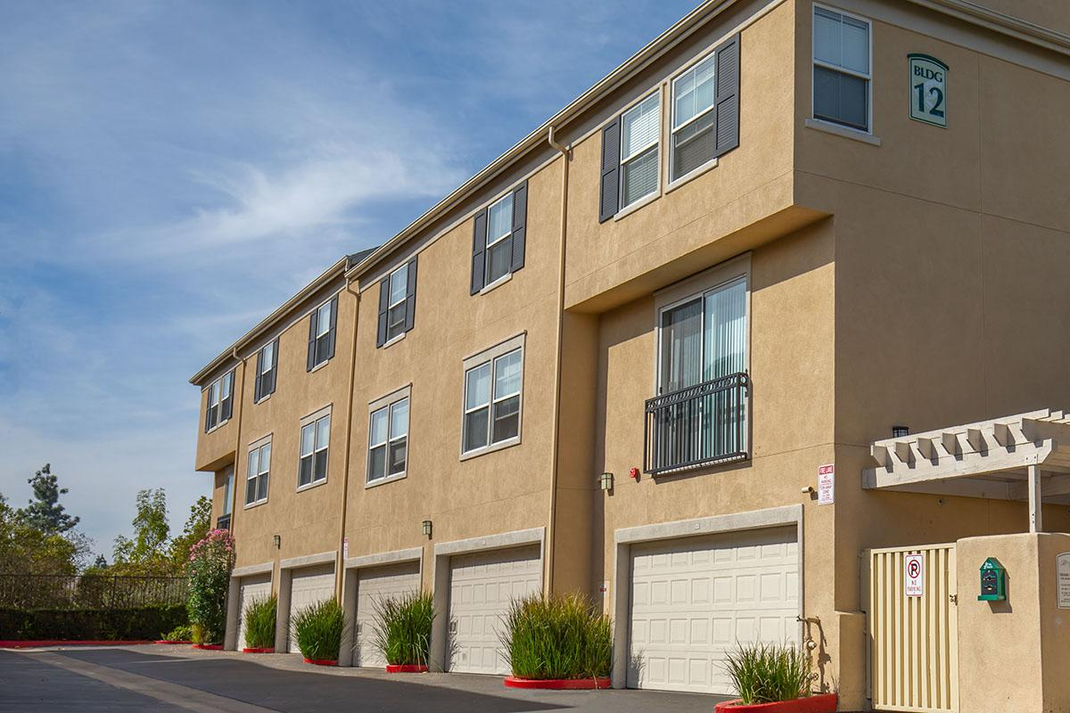 Bellecour Way Apartment Homes community building with garages