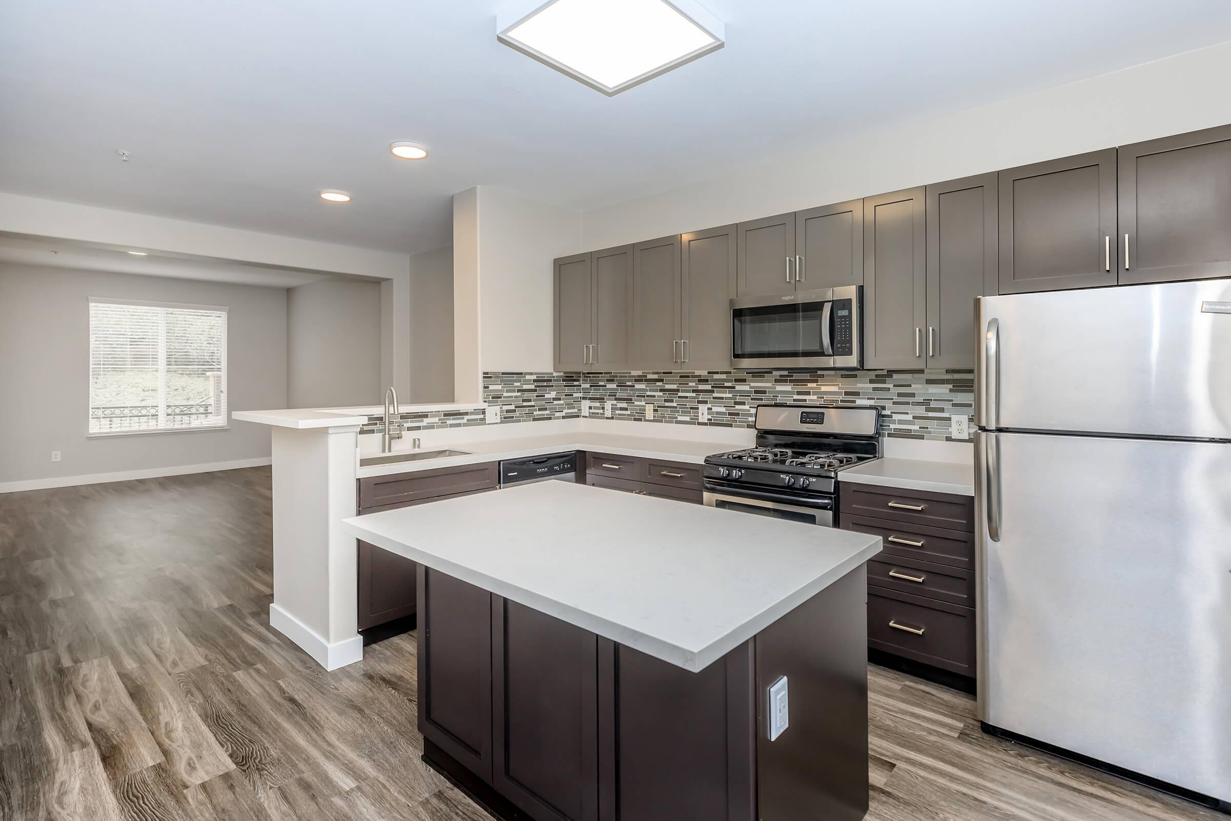 Unfurnished kitchen with an island