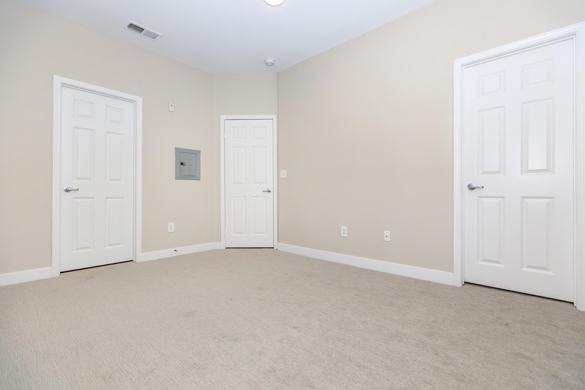 Vacant bedroom with closed doors