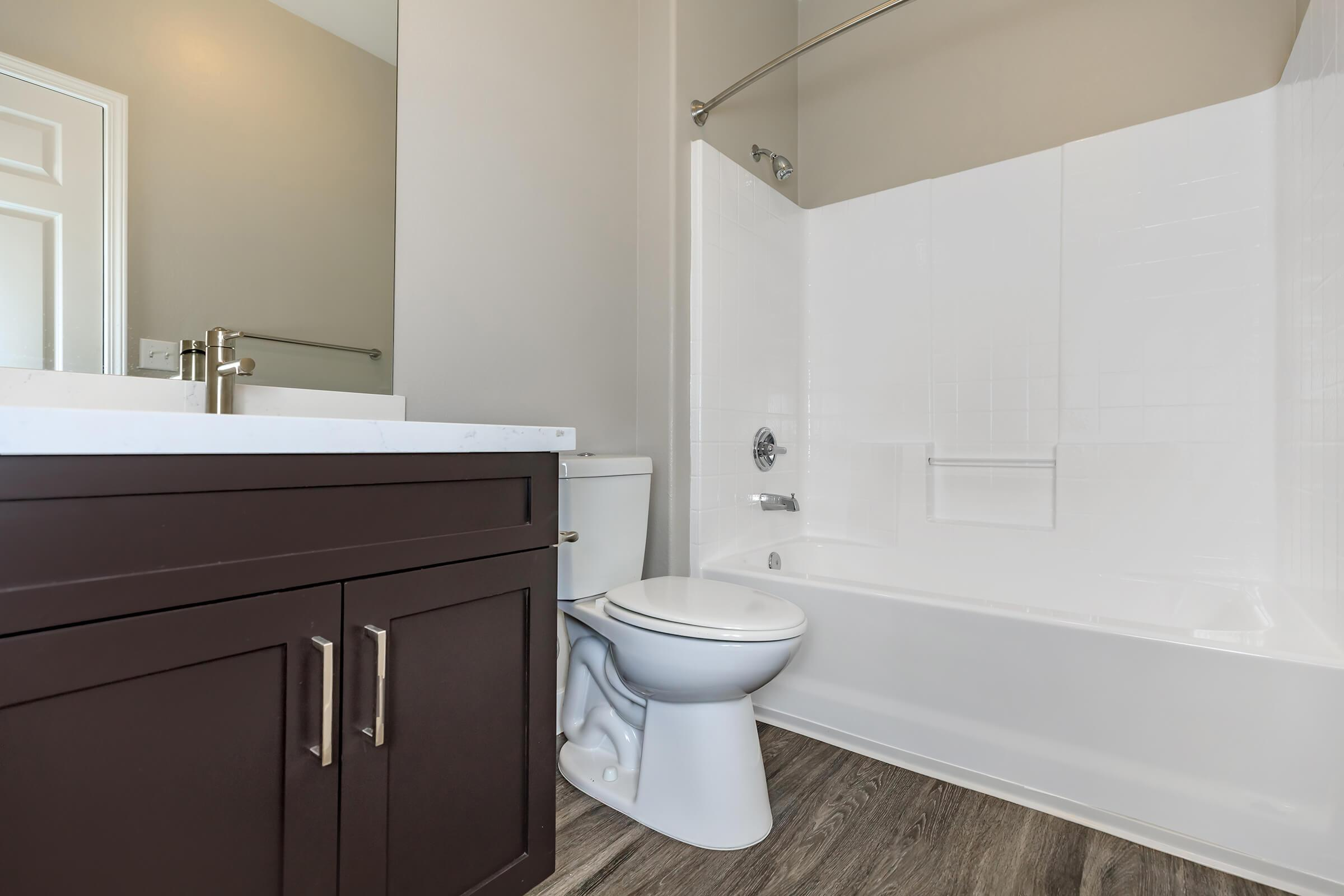 Vacant bathroom with wooden floors