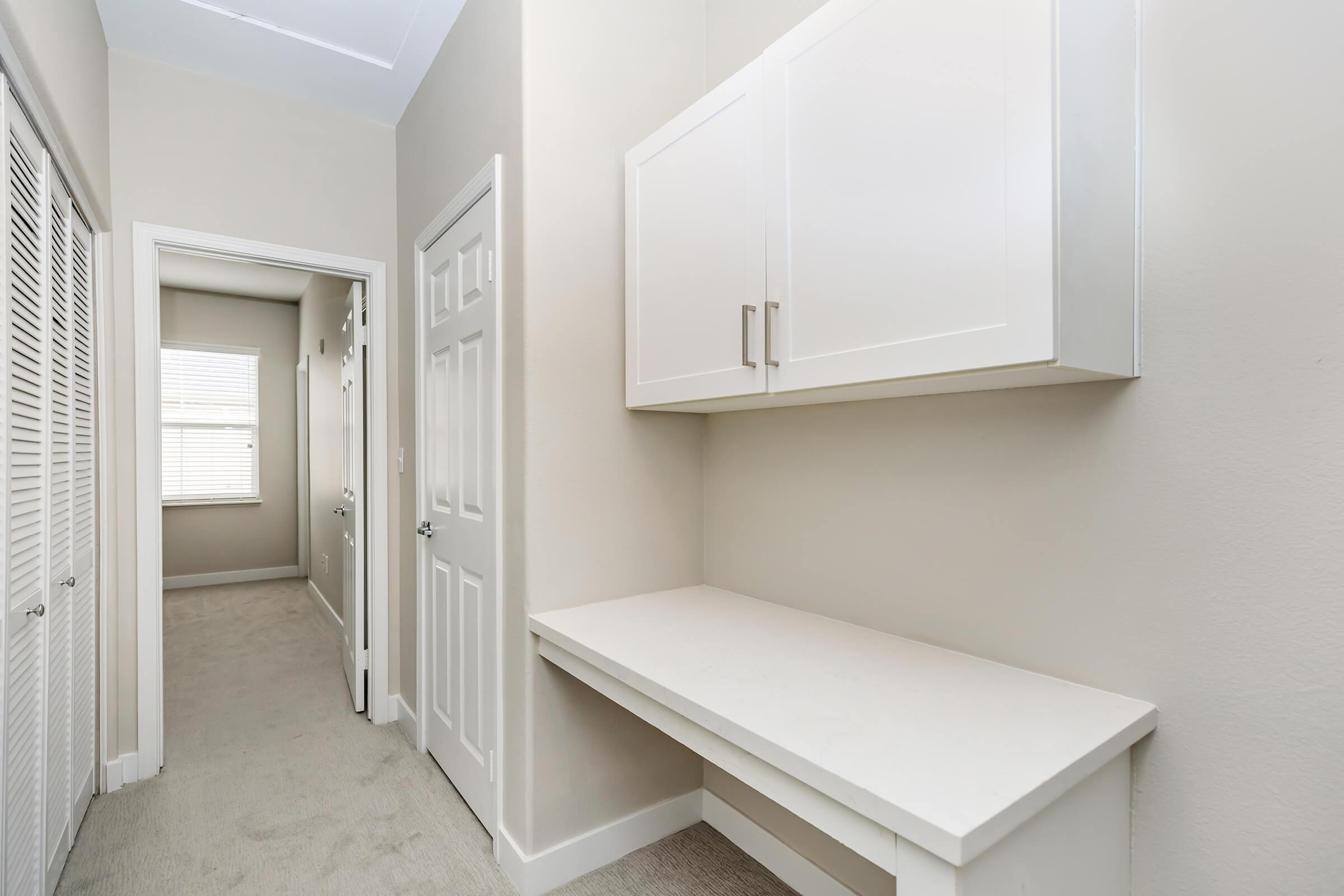 Hallway with cabinets