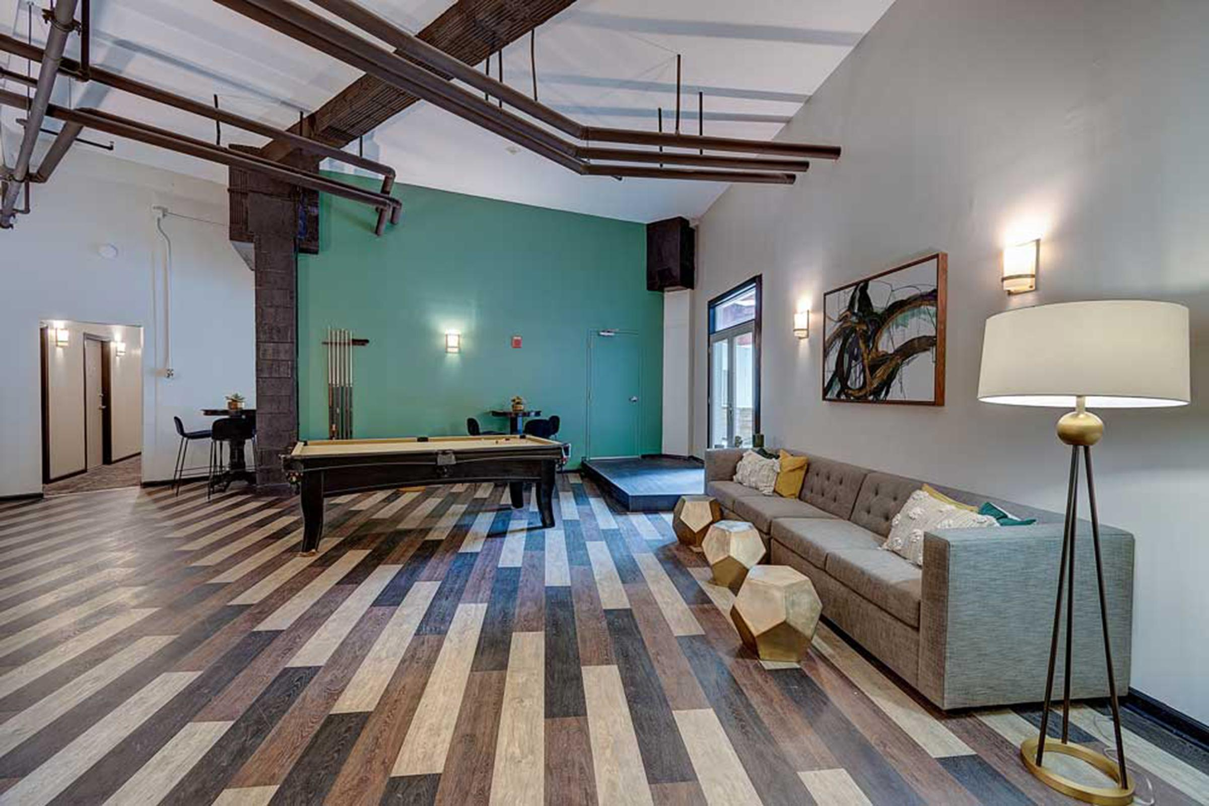 a view of a living room with a wooden floor