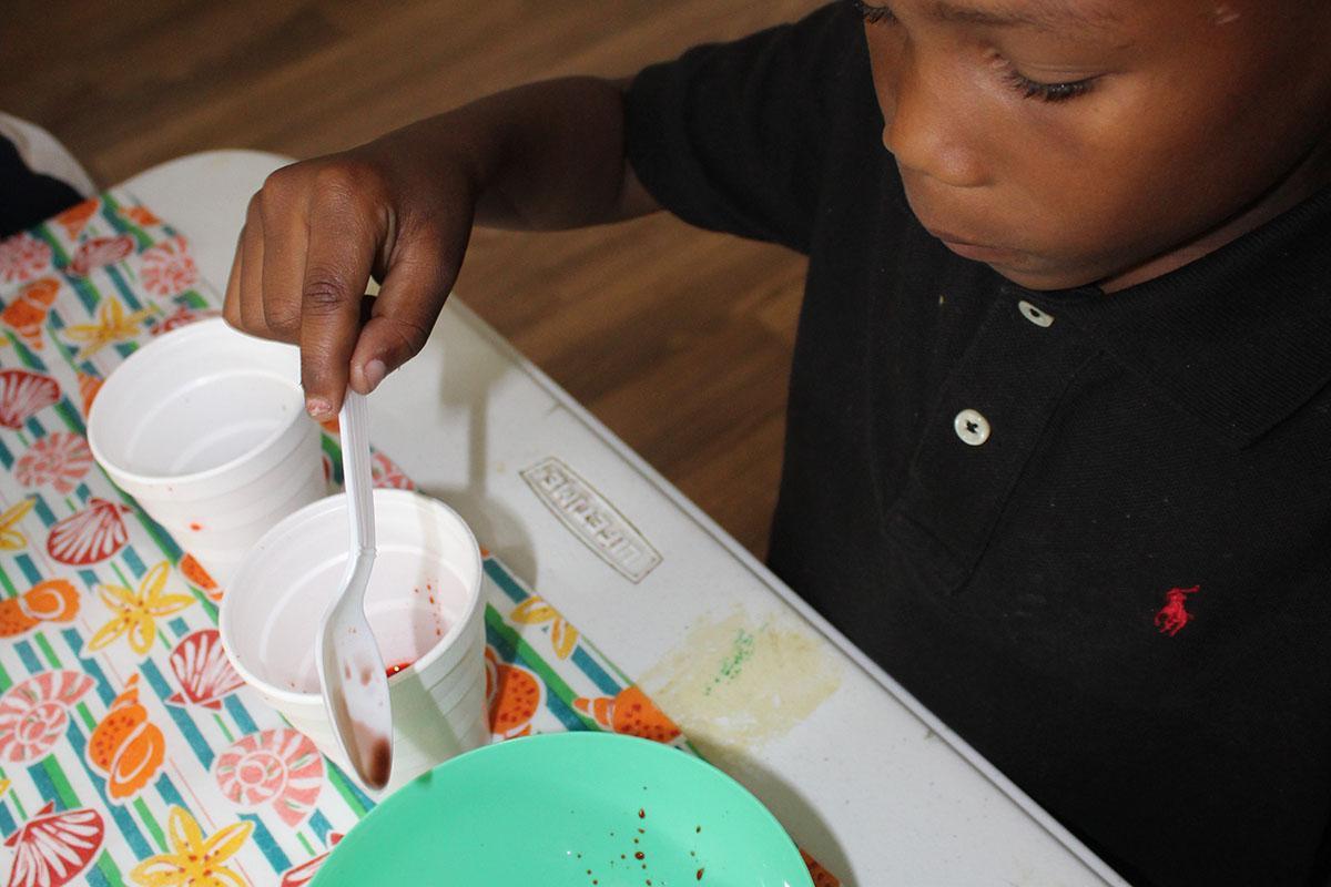 a young boy cutting a cake