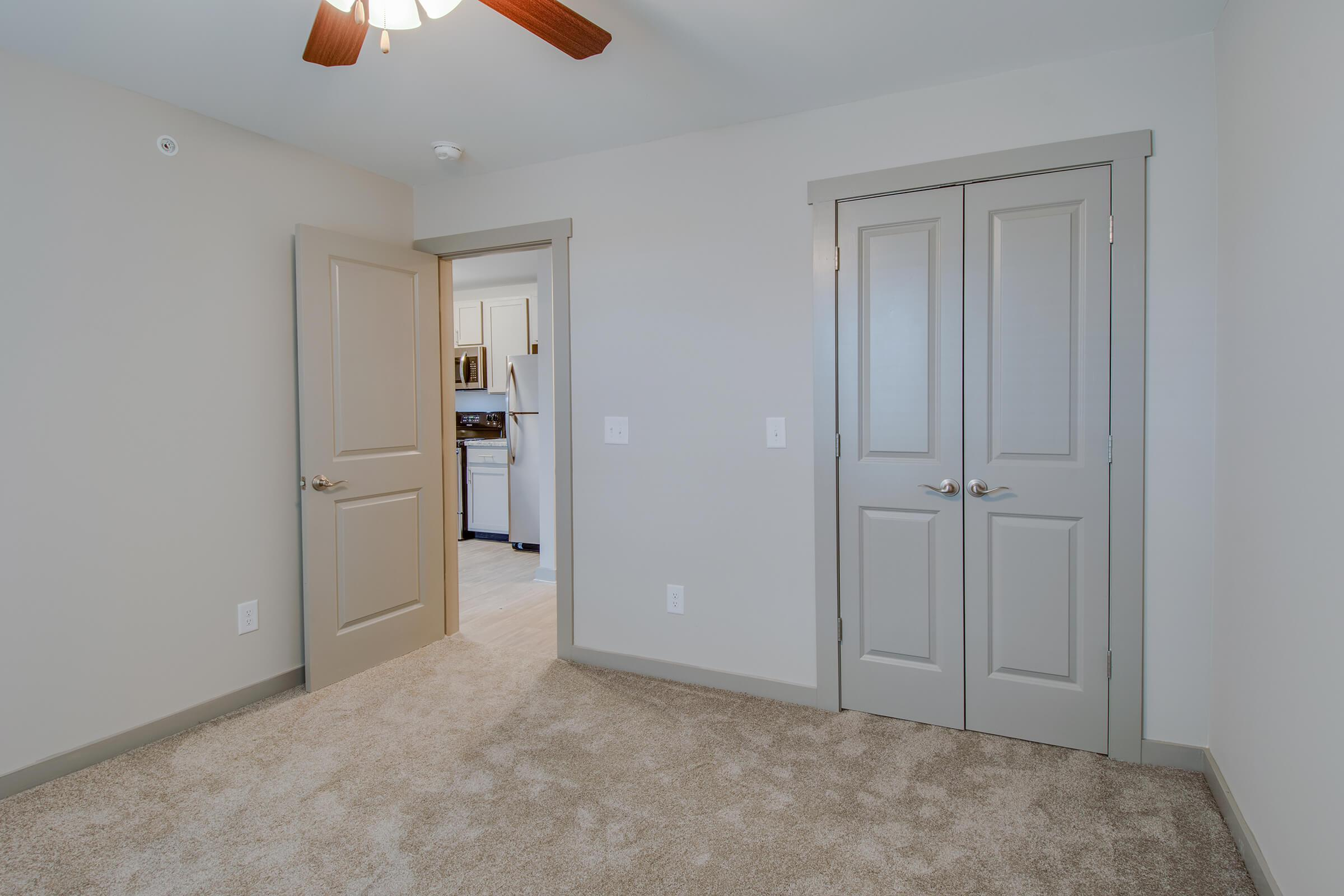 a kitchen with a white door