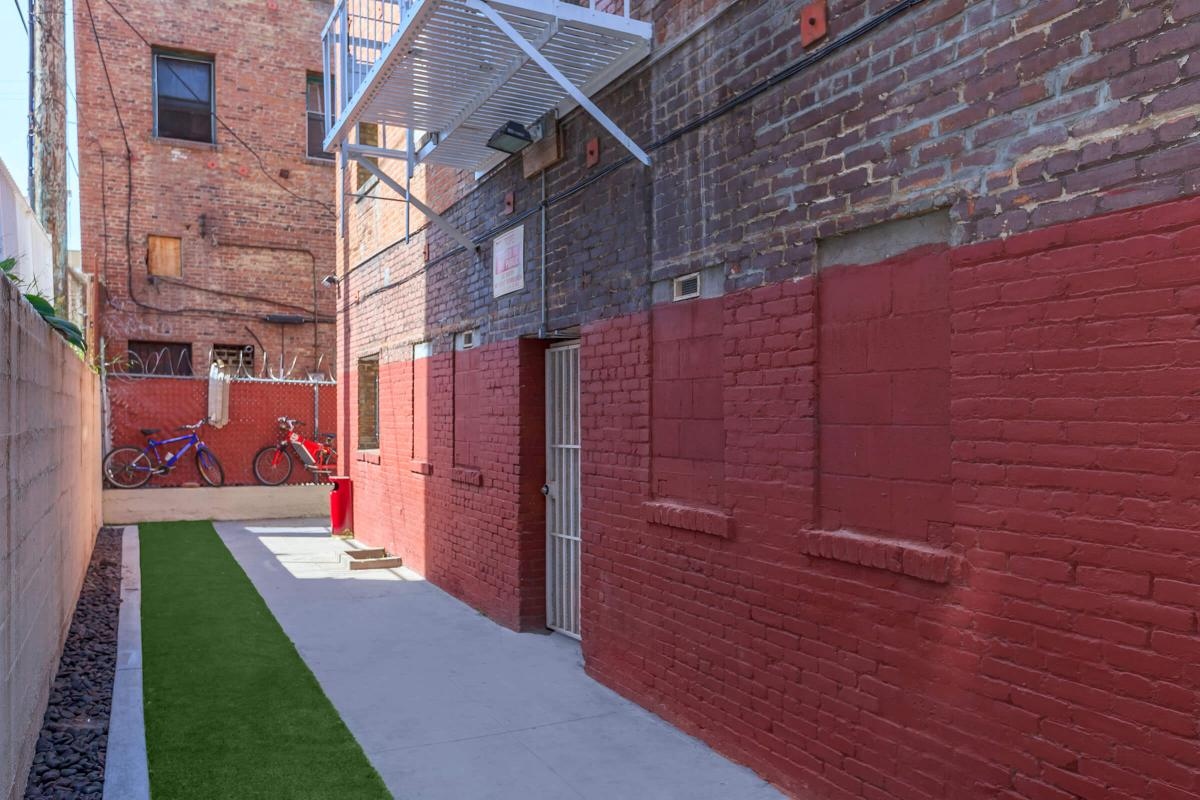 a close up of a red brick building