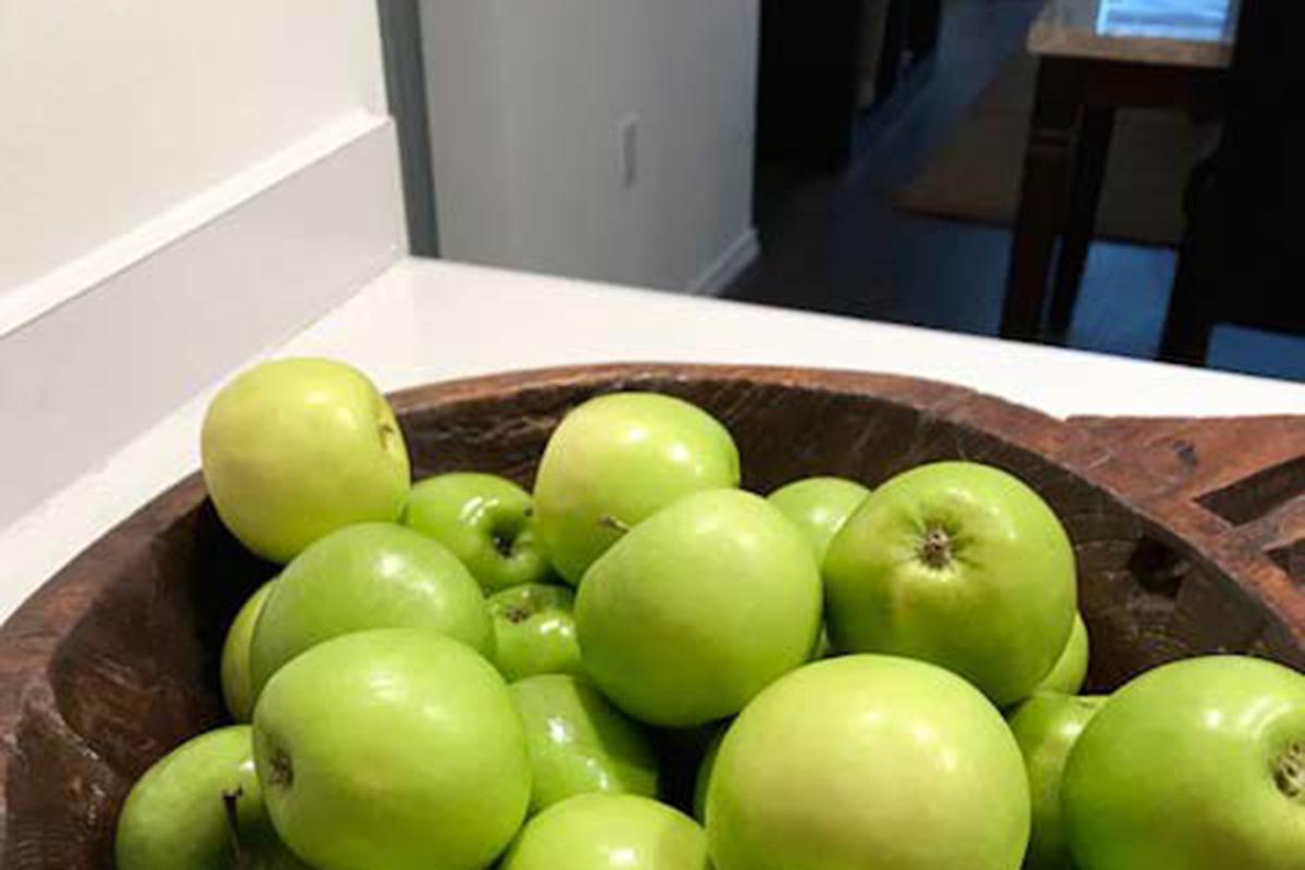 a green apple on a table